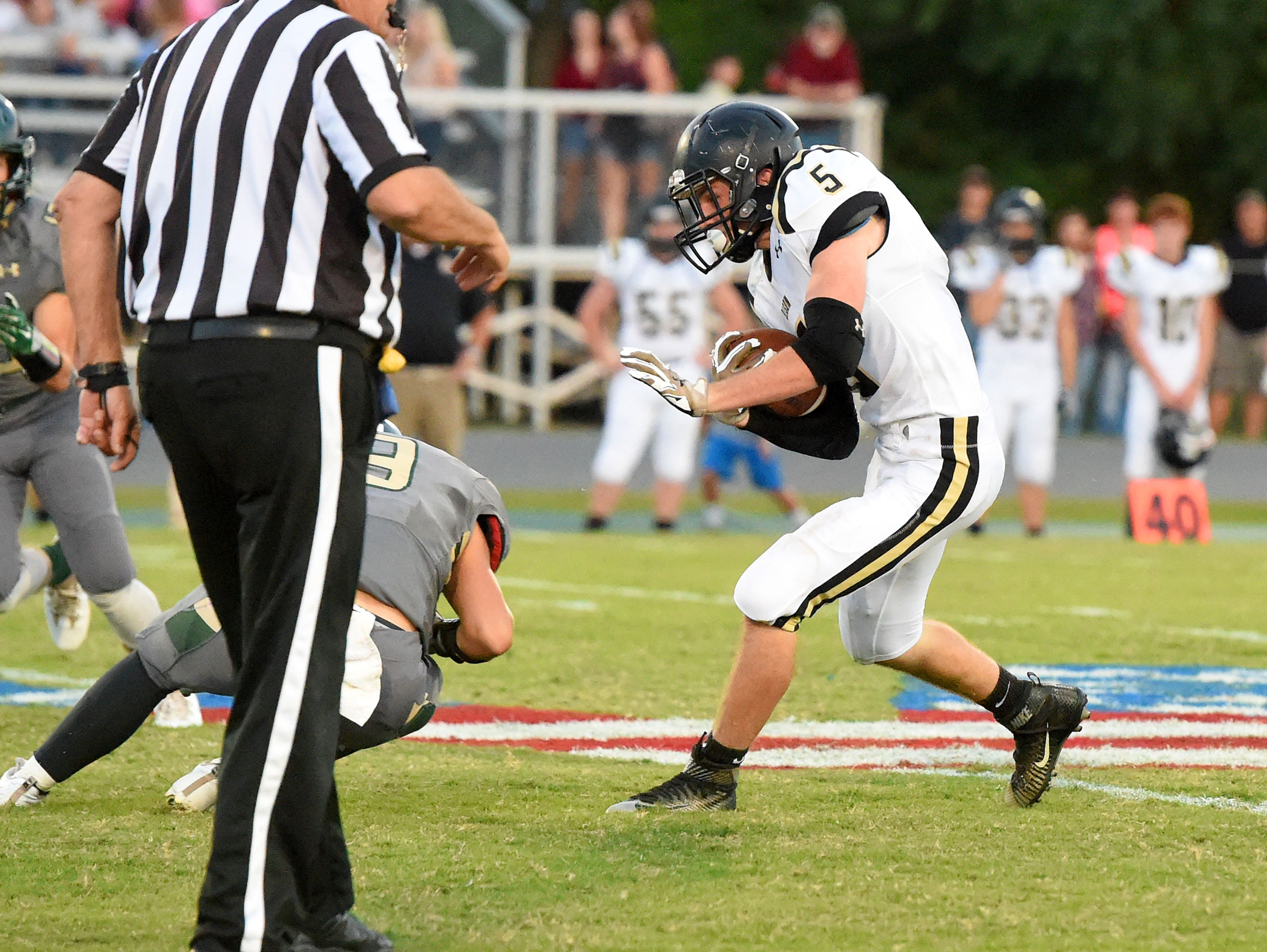 Buffalo Gap's Jacob Thompson cradles the football as he runs it for more yards during a football game played in Fishersville on Friday, Sept. 23, 2016.