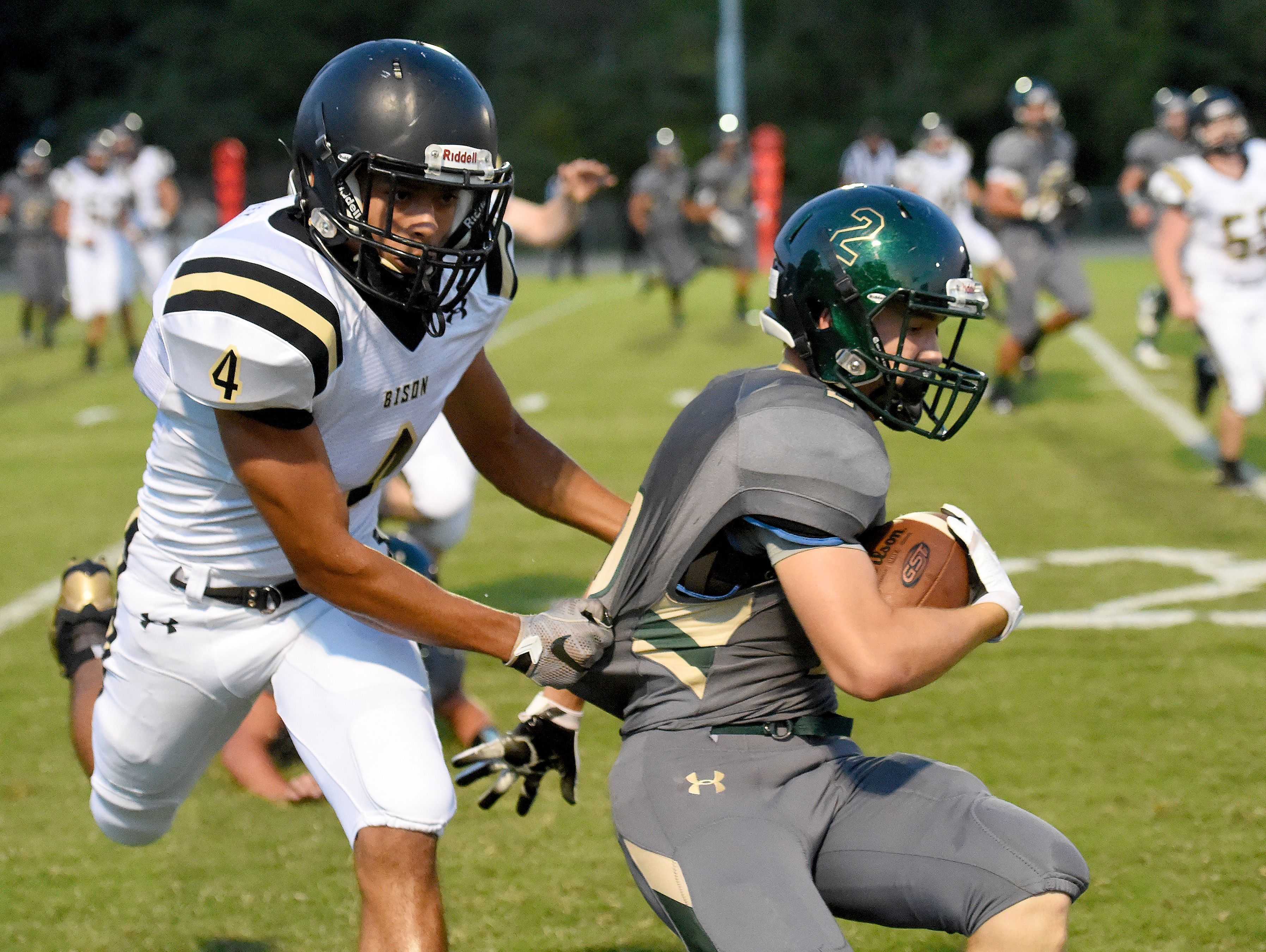 Buffalo Gap's Jay Johnson goes for the tackle against Wilson Memorial's Colton Tyree during a football game played in Fishersville on Friday, Sept. 23, 2016.
