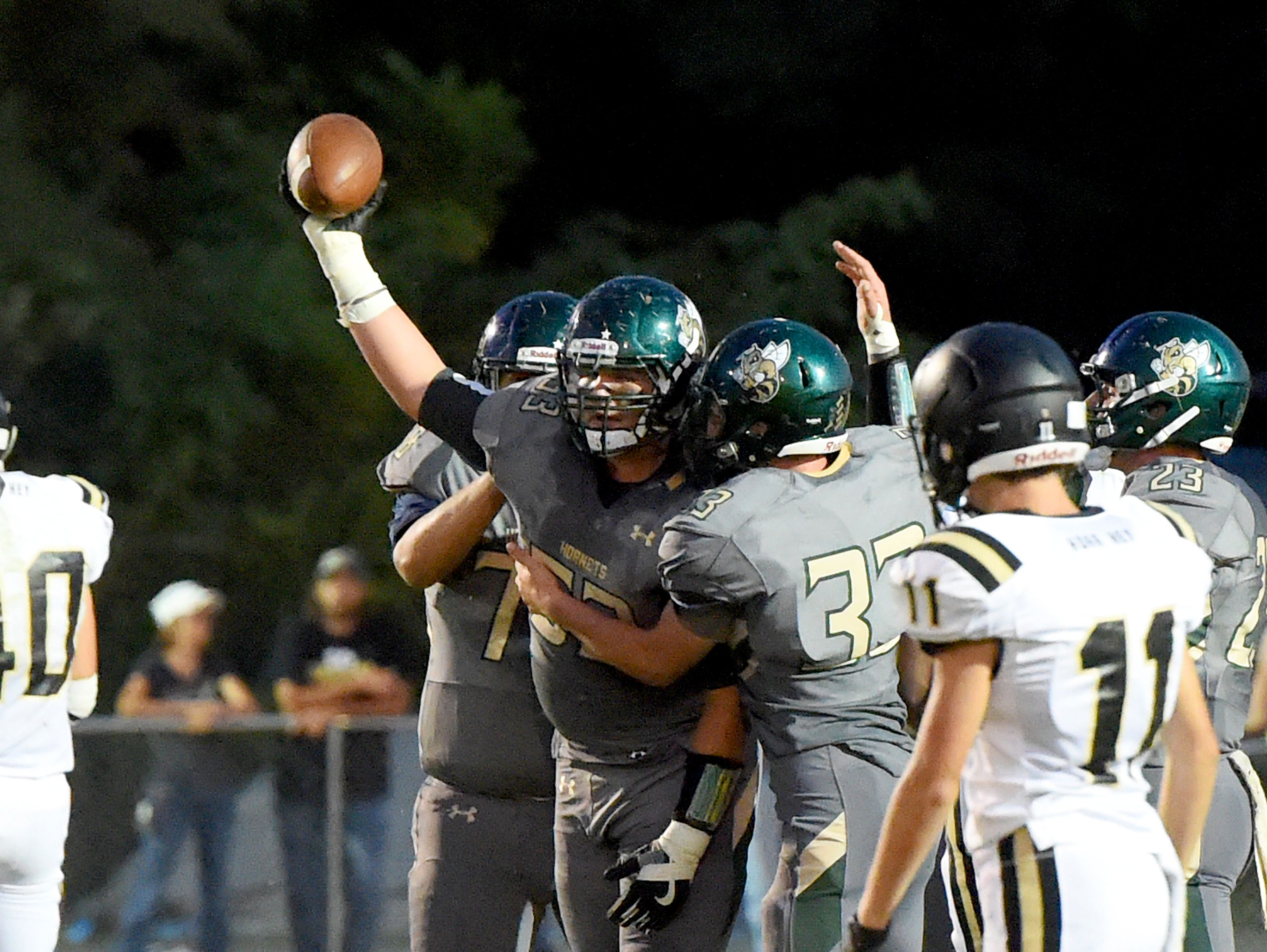 Wilson Memorial's Xavier Black holds up the football after recovering a fumble for a game turnover during a football game played in Fishersville on Friday, Sept. 23, 2016.