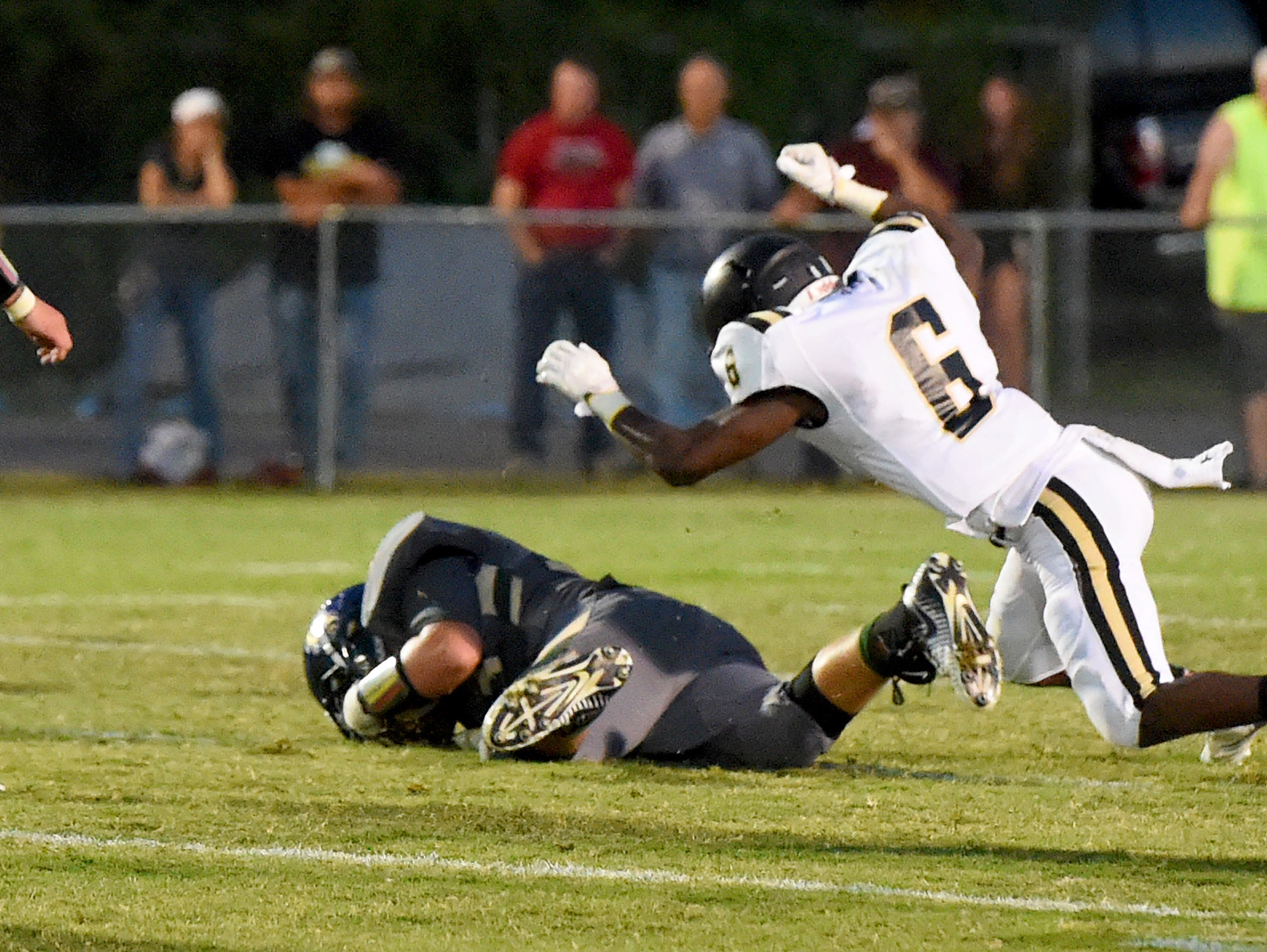 Wilson Memorial's Xavier Black dives onto a loose ball to recover a fumble for a game turnover as Buffalo Gap's Dylan Thompson dives after him during a football game played in Fishersville on Friday, Sept. 23, 2016.