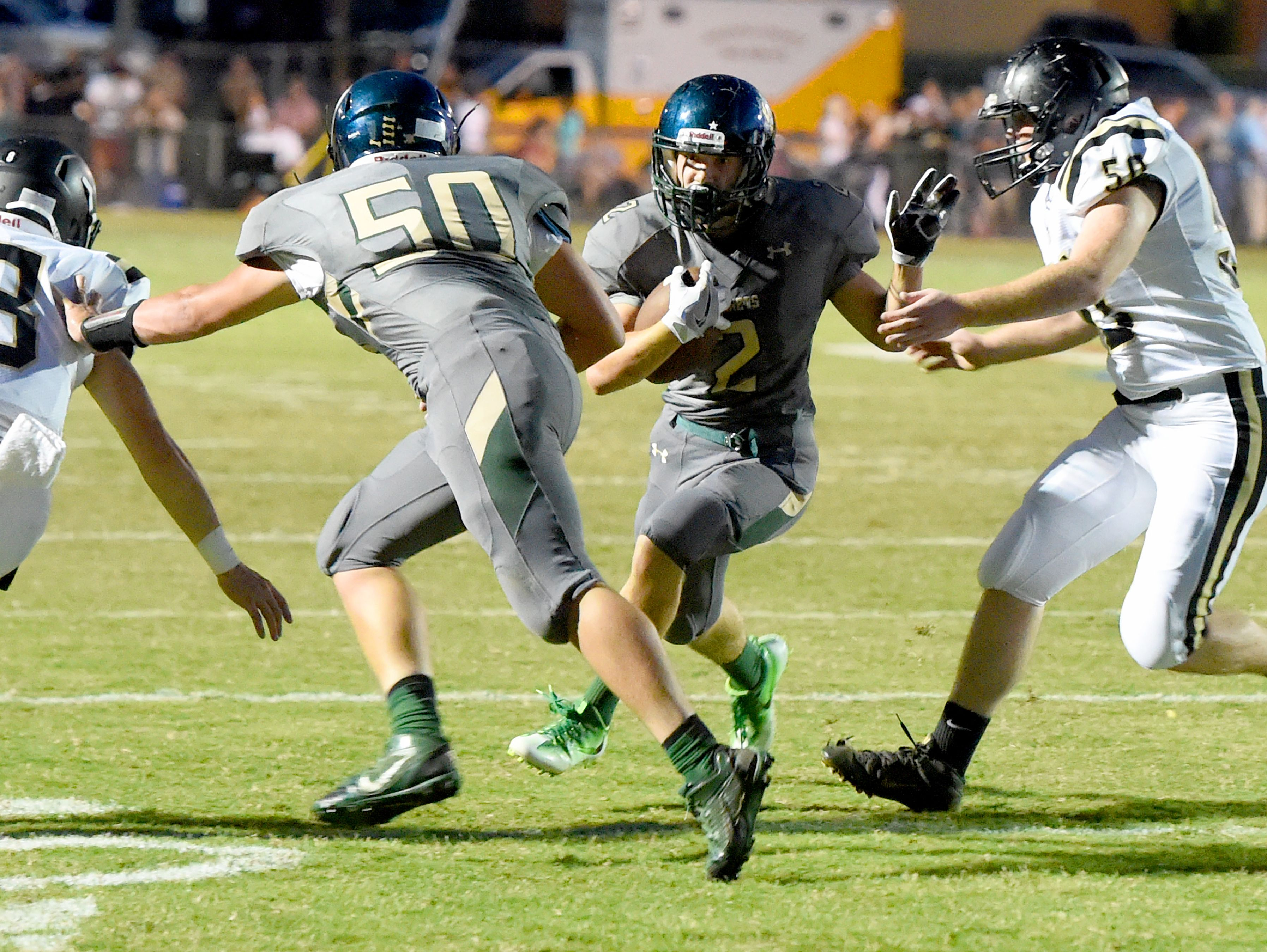 Wilson Memorial's Colton Tyree moves the ball as Buffalo Gap's Walker Hostetter closes in for the tackle during a football game played in Fishersville on Friday, Sept. 23, 2016.