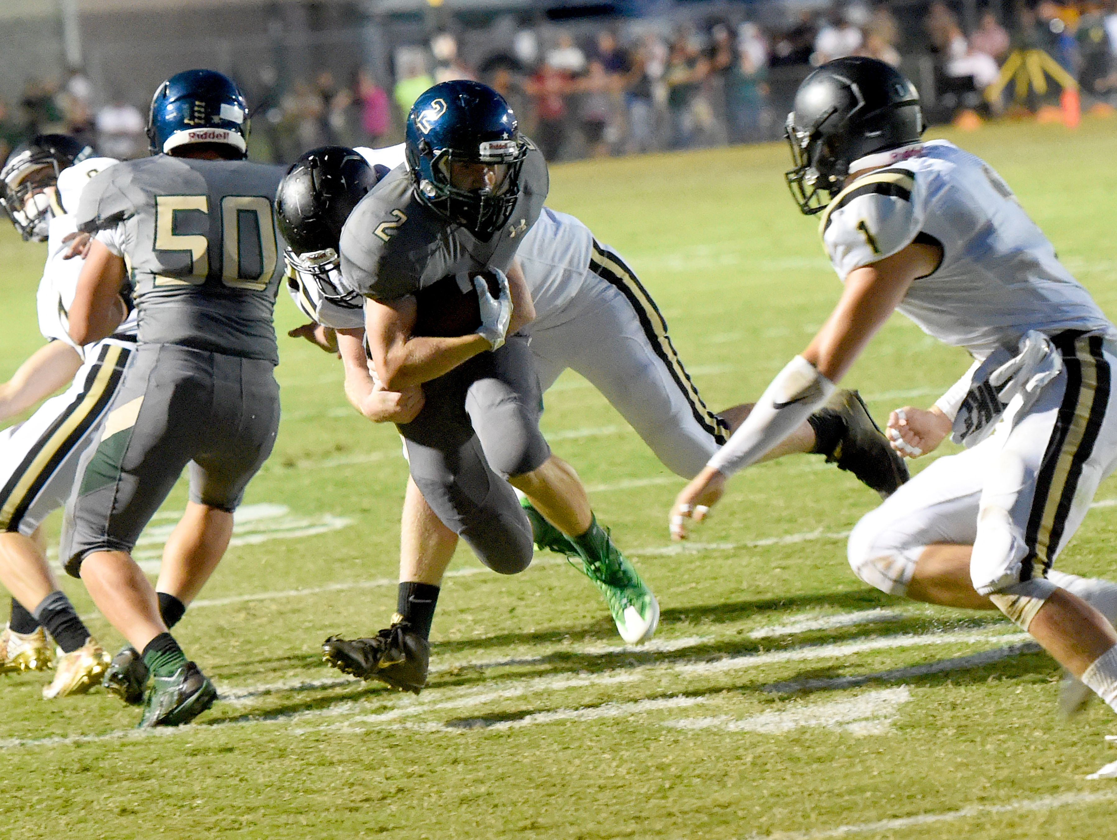 Wilson Memorial's Colton Tyree holds onto the ball as he Buffalo Gap's Walker Hostetter tackles him during a football game played in Fishersville on Friday, Sept. 23, 2016.