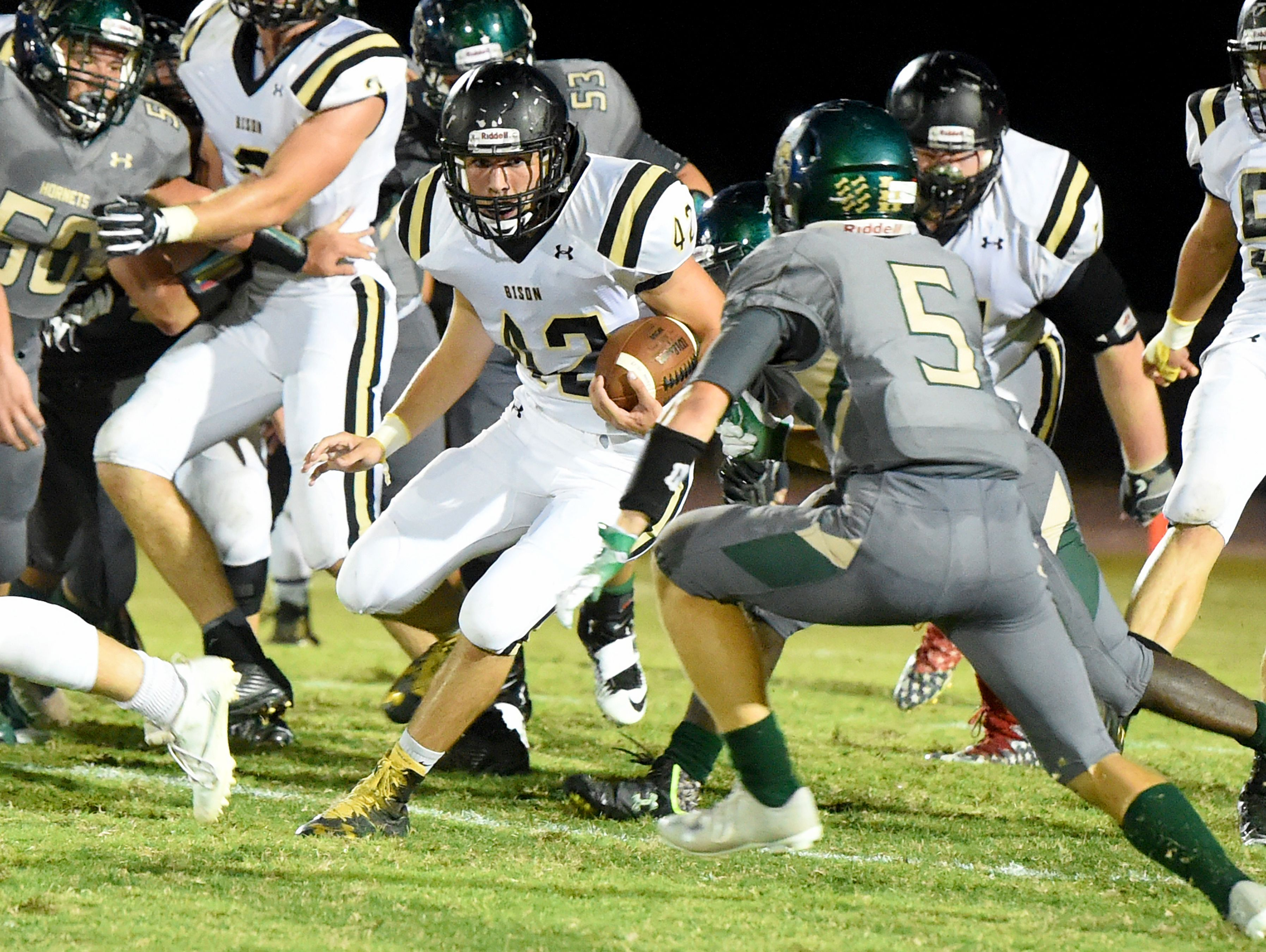 Buffalo Gap's Jake Callison runs the football for 22 yards and a first down during a football game played in Fishersville on Friday, Sept. 23, 2016.