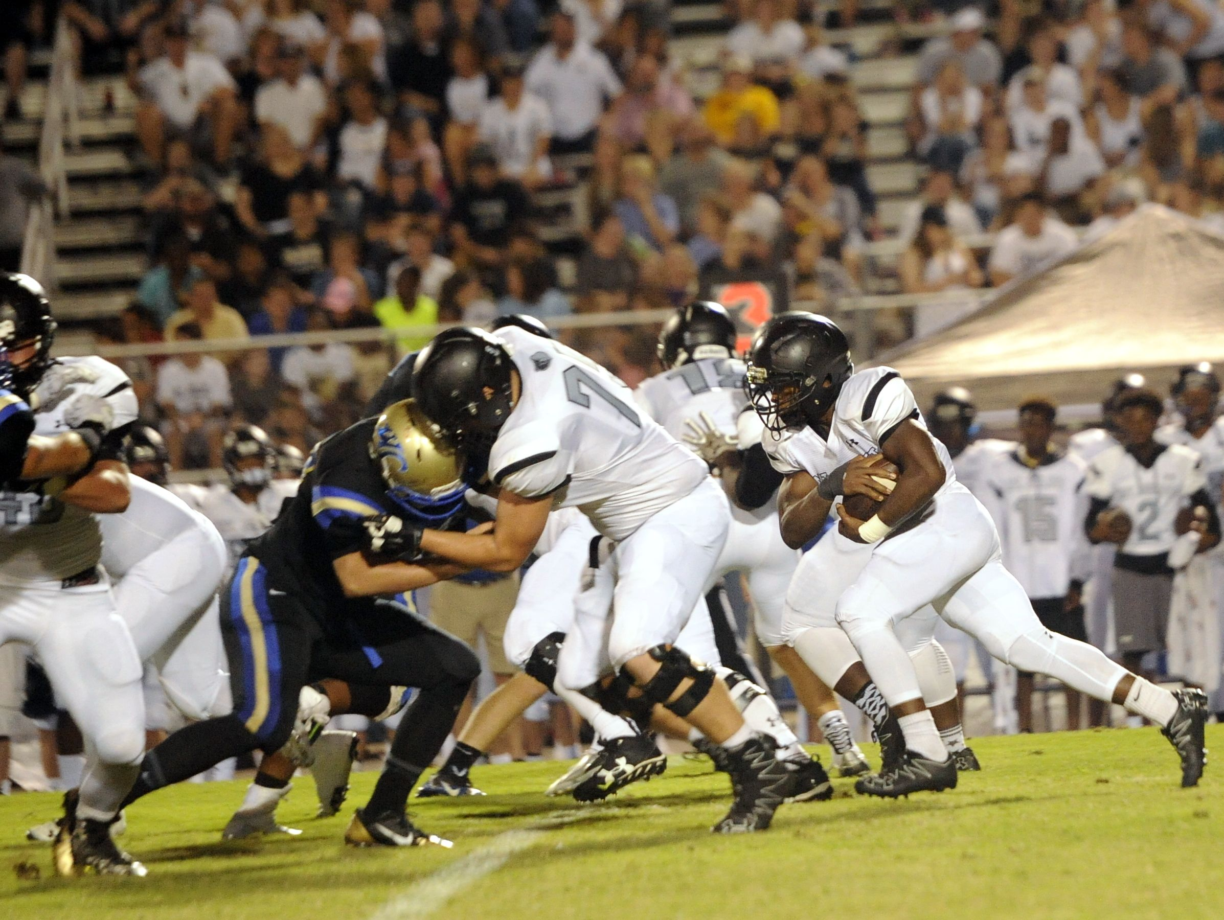 Mt. Juliet sophomore running back Marcello Walton carries the football during the second quarter.