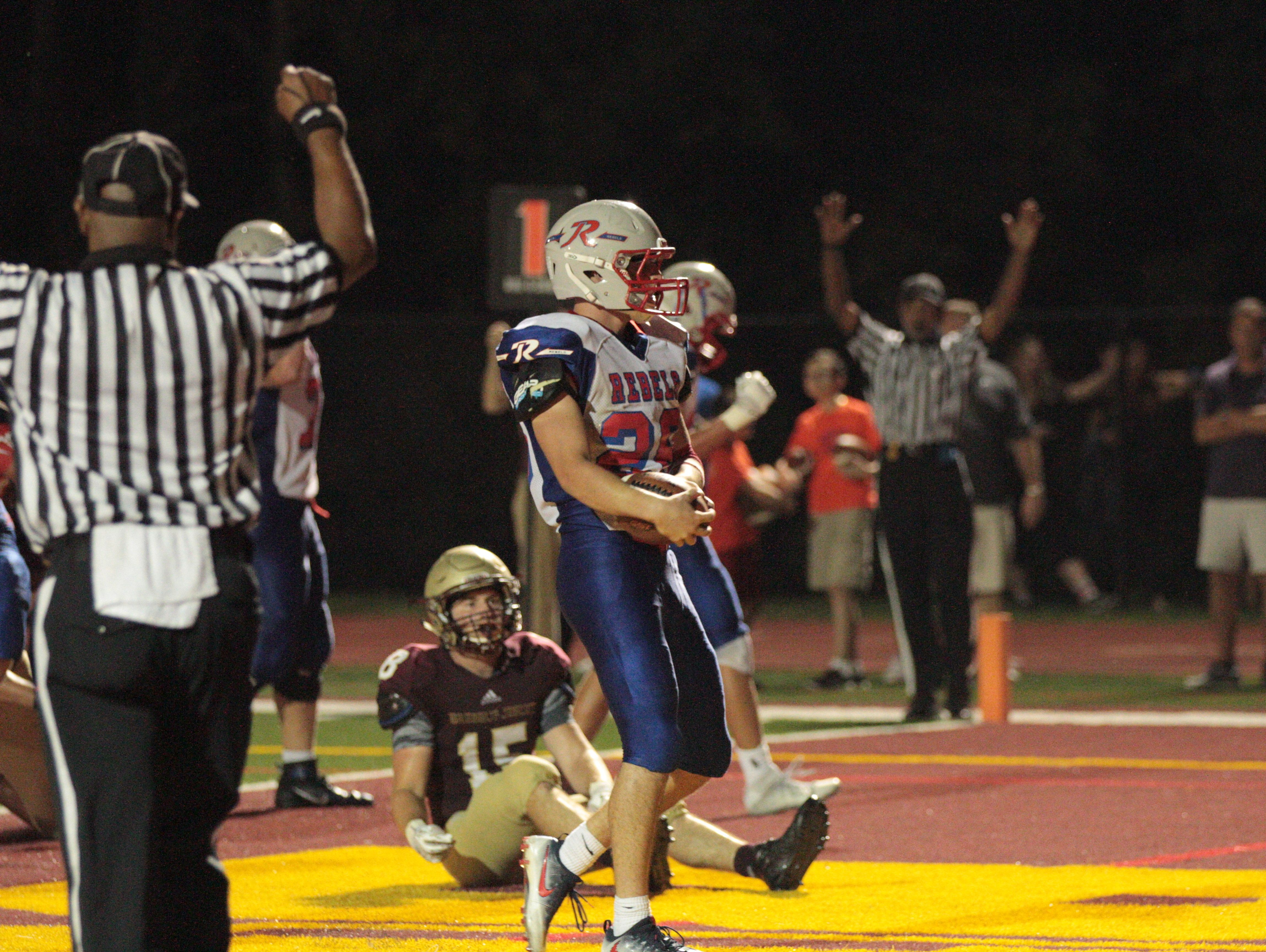 Roncalli running back Kenny Gillum scores on a two-yard touchdown run against Brebeuf on Friday night. Gillum finished with 62 yards on 17 carries.