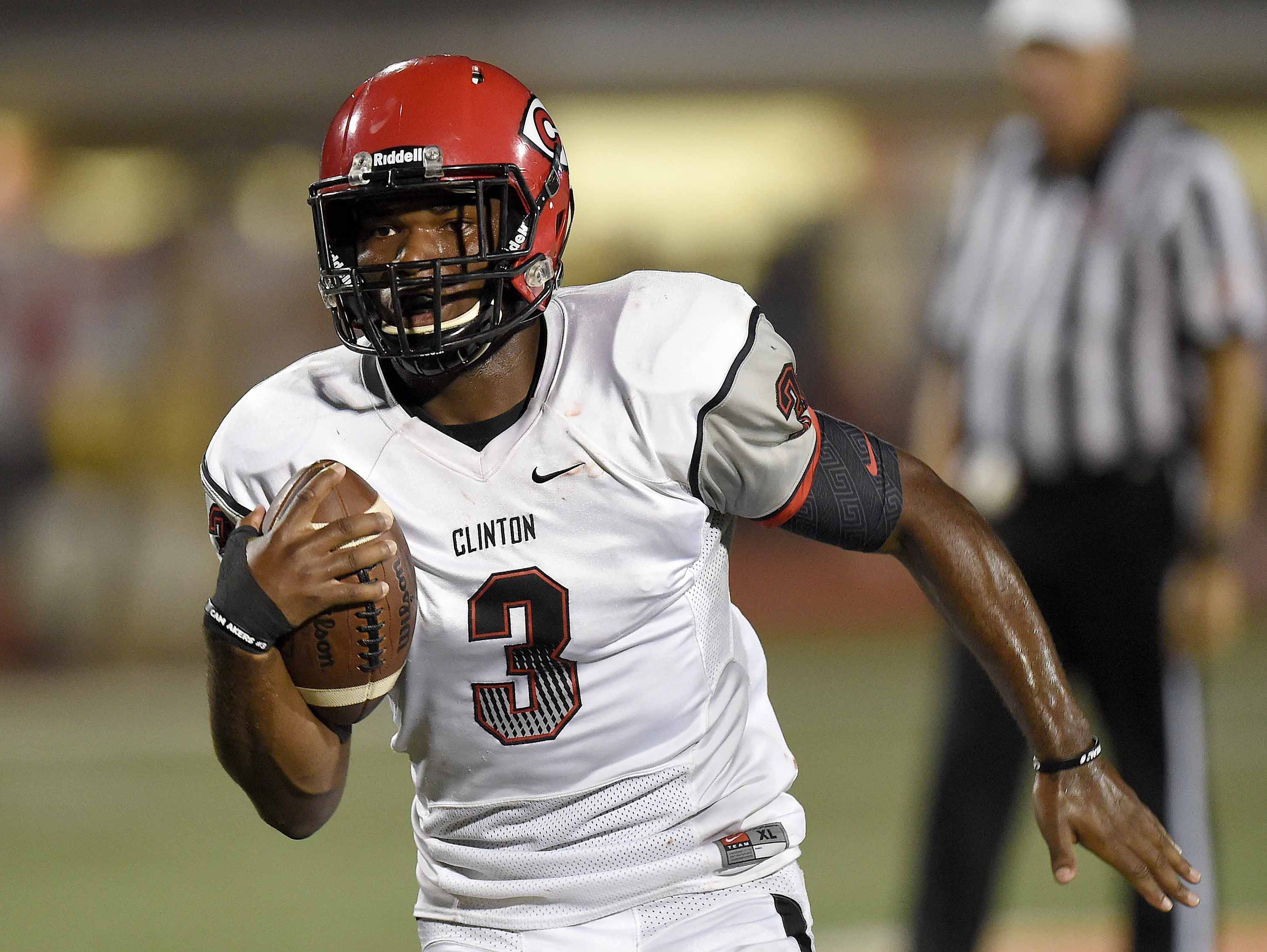 Clinton quarterback Cam Akers sprints down the field for a touchdown against Madison Central on Friday.