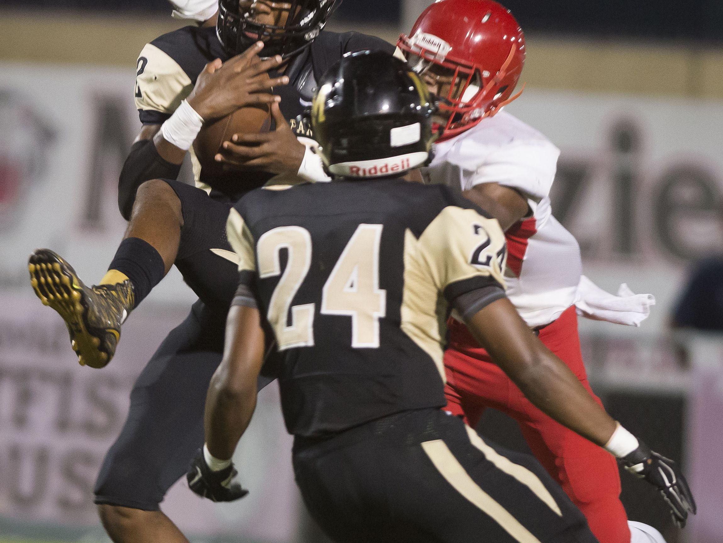 Milton High School defensive back Martavious Odom (No. 2) intercepts a Pine Forest High pass inside the 5-yard line during Friday night's game against the Eagles.