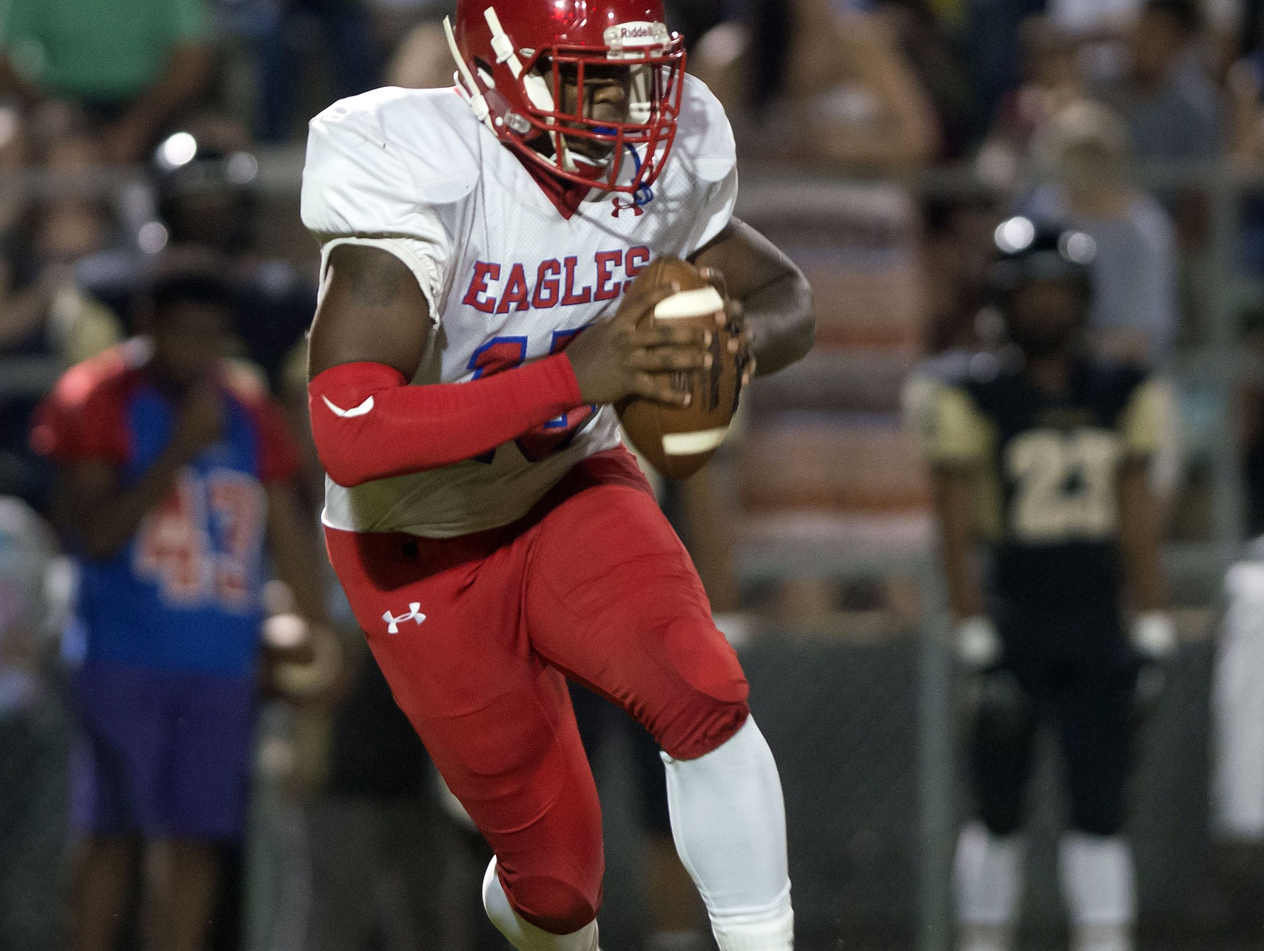 Pine Forest quarterback Xavier Saulsberry, (No. 15) rolls out of the pocket on a keeper against Milton High during Friday nights game.