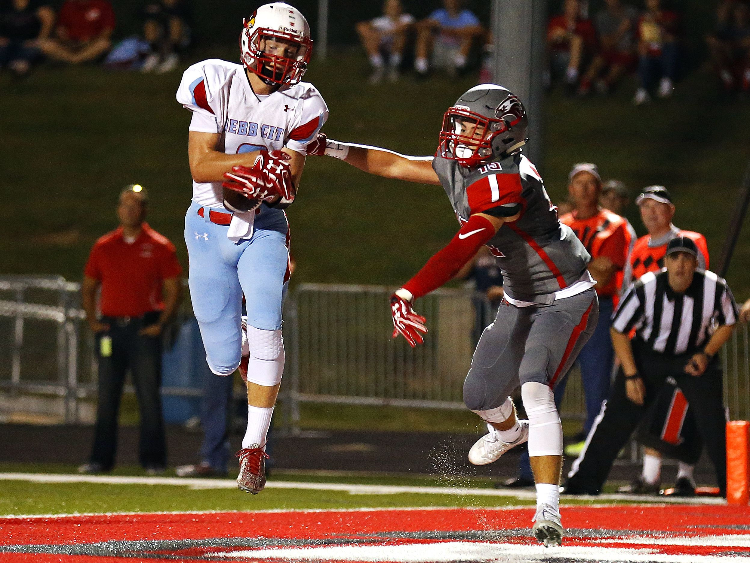 Webb City High School wide receiver Alex Gaskill (6) catches a pass in front of Eagles defensive back Spencer Stoneman (15) to score a two-point conversion during second quarter action of the football game between Nixa High School and Webb City High School at Eagles Stadium in Nixa, Mo. on Sept. 23, 2016. Webb City won the game 34-10.