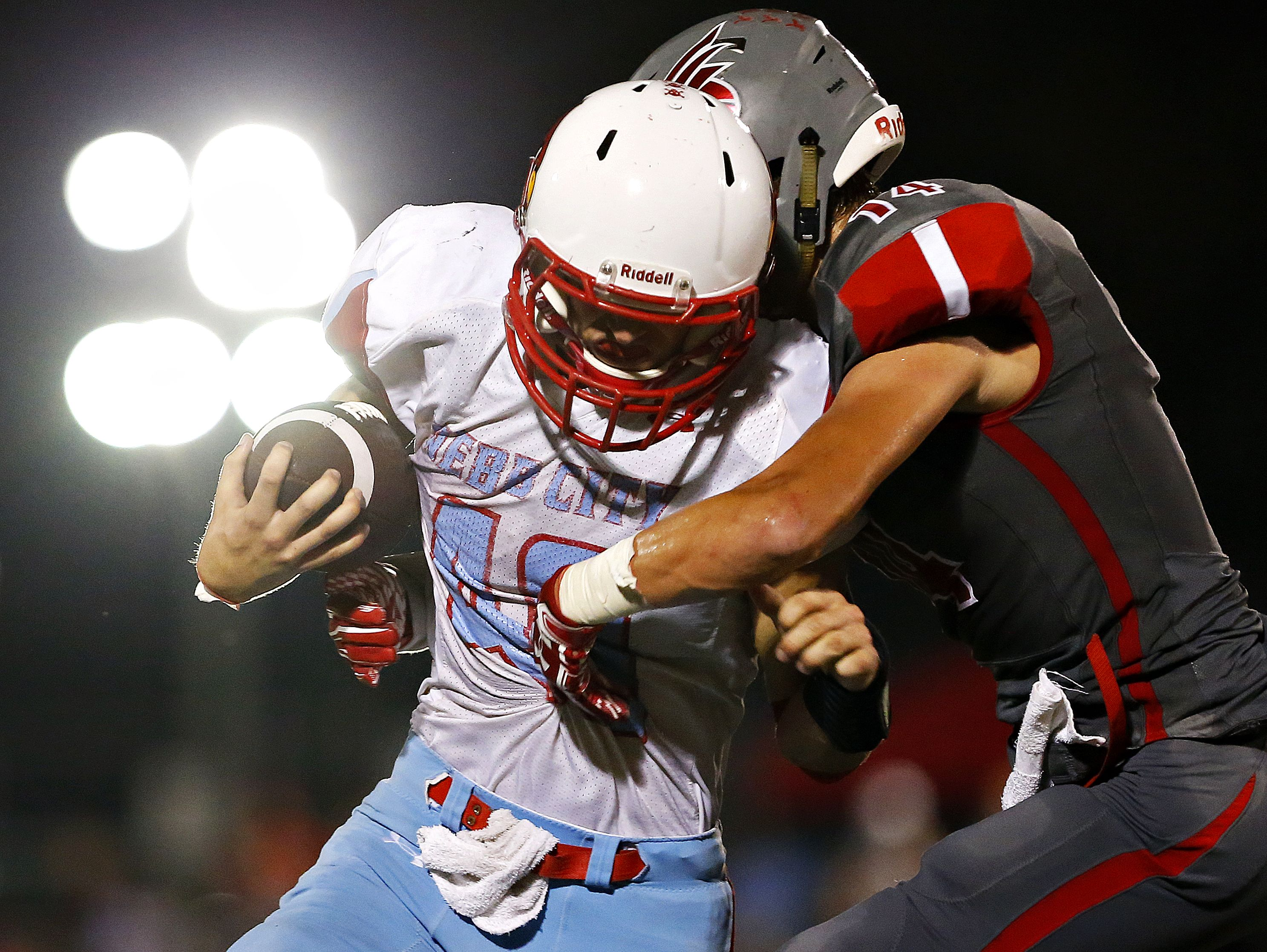 Webb City High School running back Cameron Baker (40) tries to shake off Eagles defensive back Jack Sanders (14) during second quarter action of the football game between Nixa High School and Webb City High School at Eagles Stadium in Nixa, Mo. on Sept. 23, 2016. Webb City won the game 34-10.
