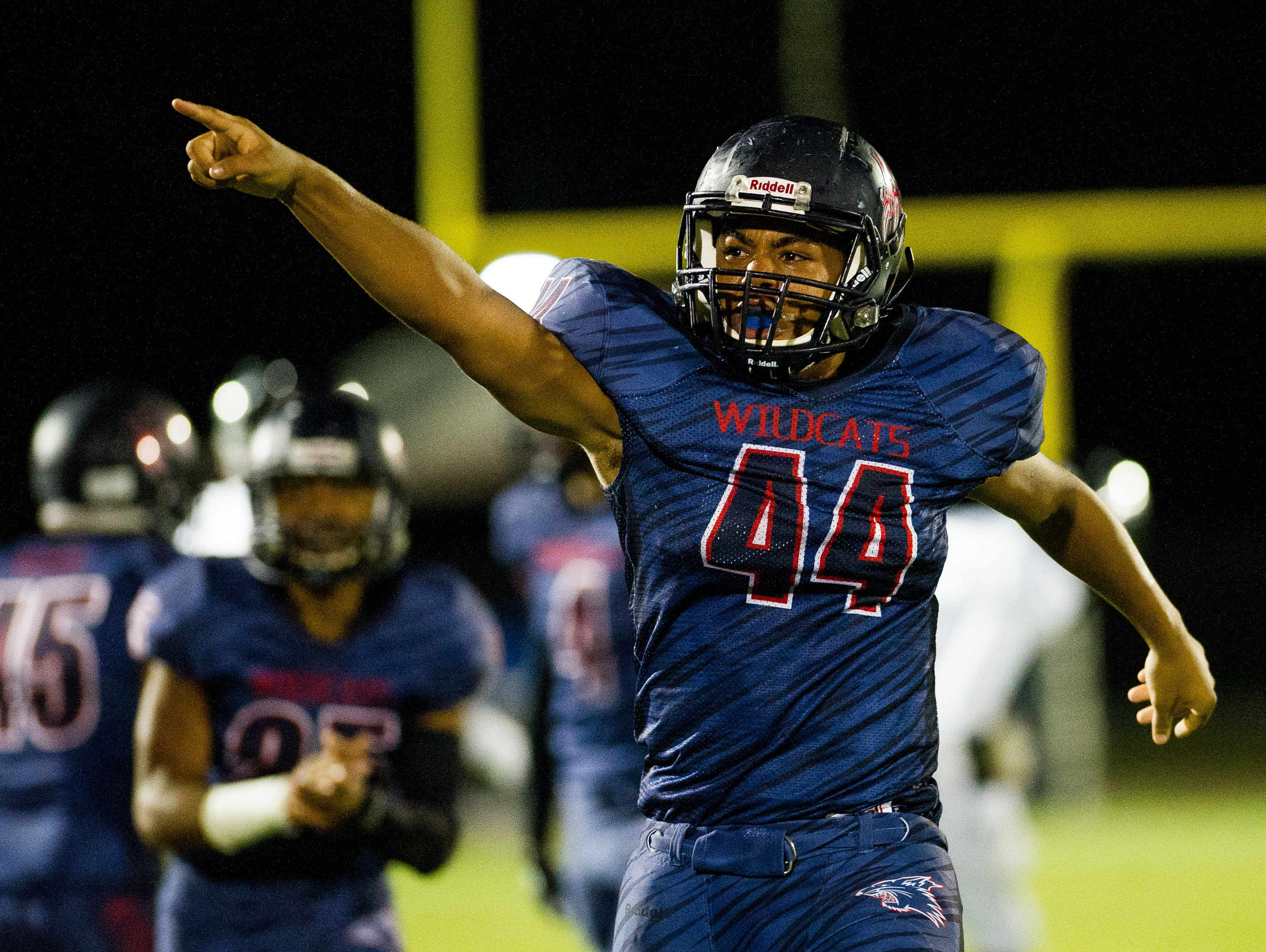Estero High School's Dj Adams reacts to a fumble recovery early in the first half of a game against Gulf Coast High School in Estero, Fla., on Friday, Sept. 23, 2016.