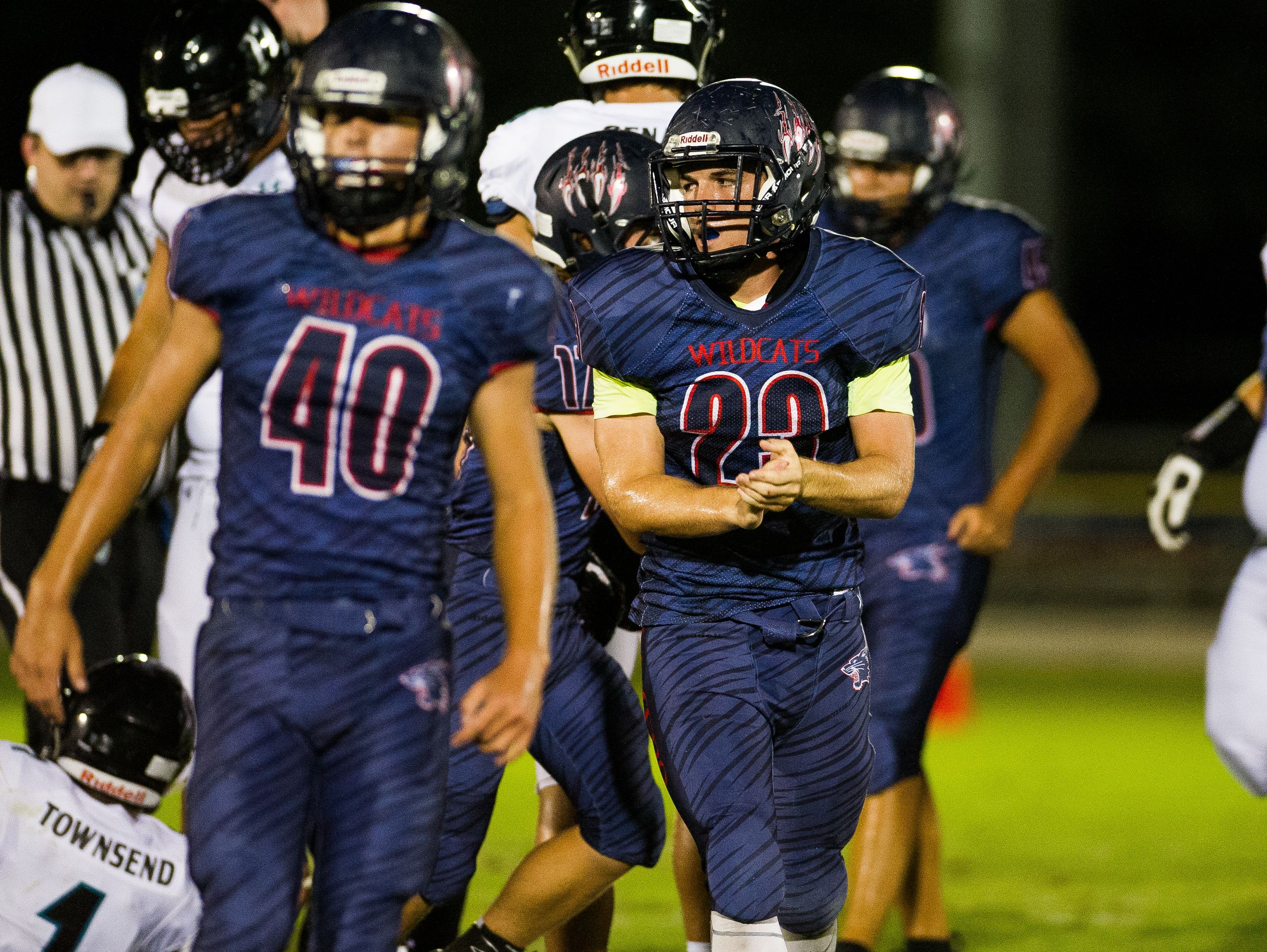 Estero High School's Jonathan Rauss(23) reacts to a play during a game against Gulf Coast High School in Estero, Fla., on Friday, Sept. 23, 2016.