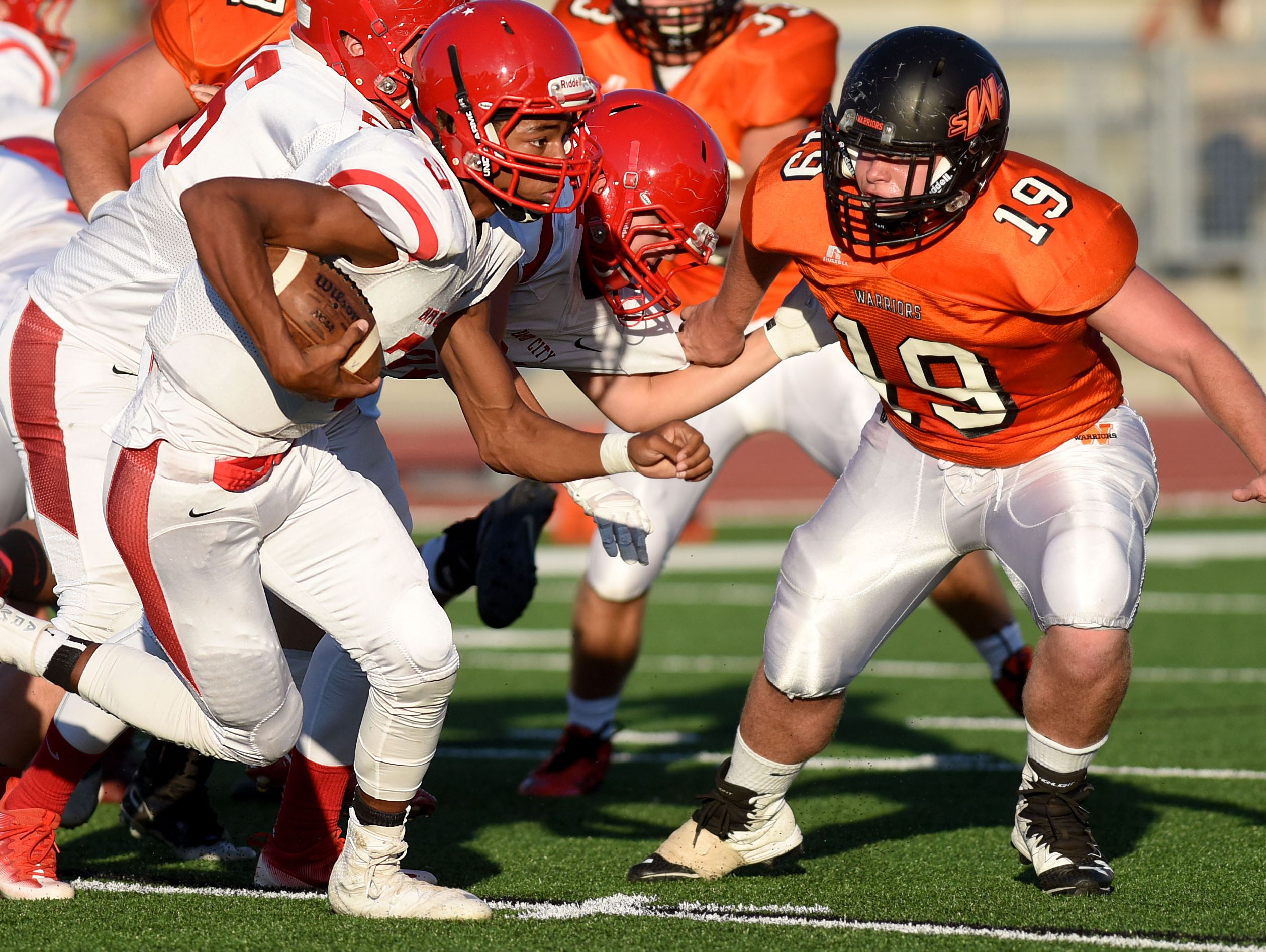Rapid City Central's Kailleb Walton-Blanden (3) eludes Washington's Dominick Warmbein during their game at Howard Wood Field on Friday.
