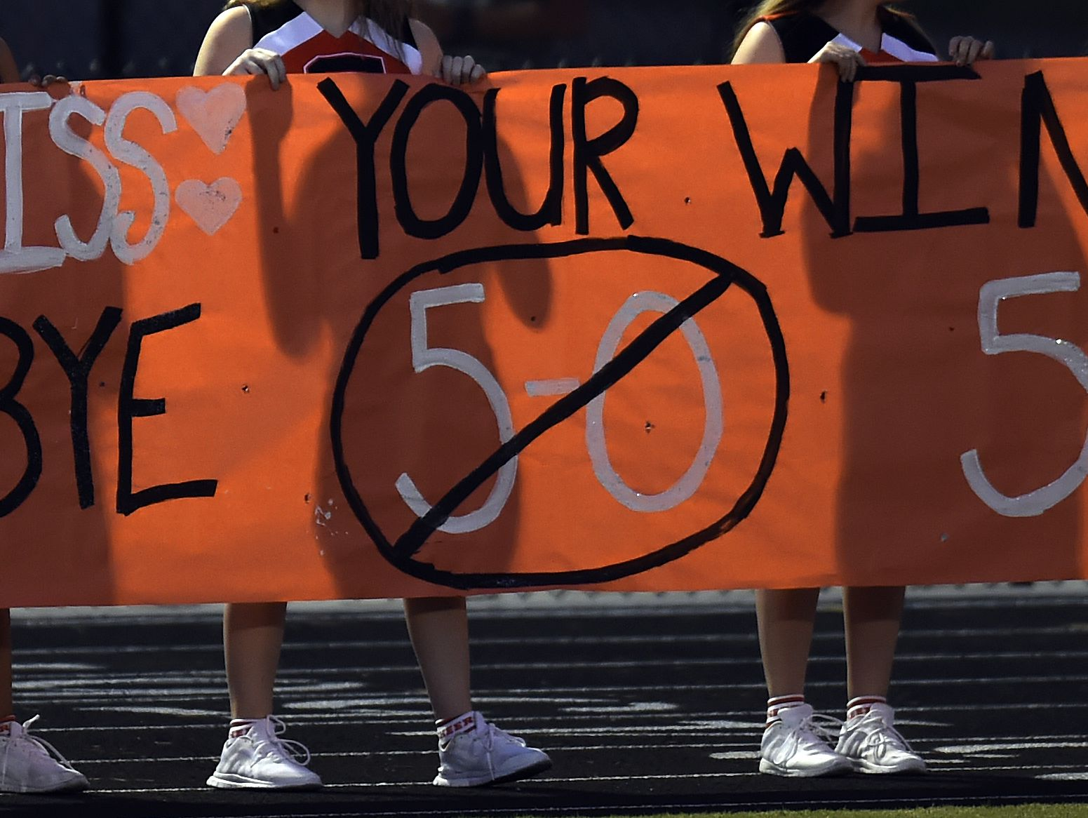 Stratford HIgh School cheerleaders hold a banner before a high school football game against Marshall County High School on Friday, Sept. 23, 2016, in Nashville, Tenn.