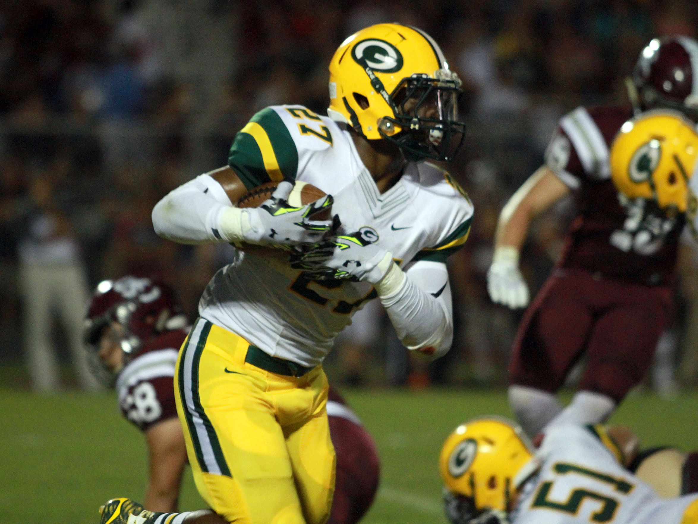 Gallatin running back Jordan Mason rushes against Station Camp during Friday's game. Mason rushed for 298 yards and three touchdowns on 40 carries in the Green Wave's 34-27 victory.