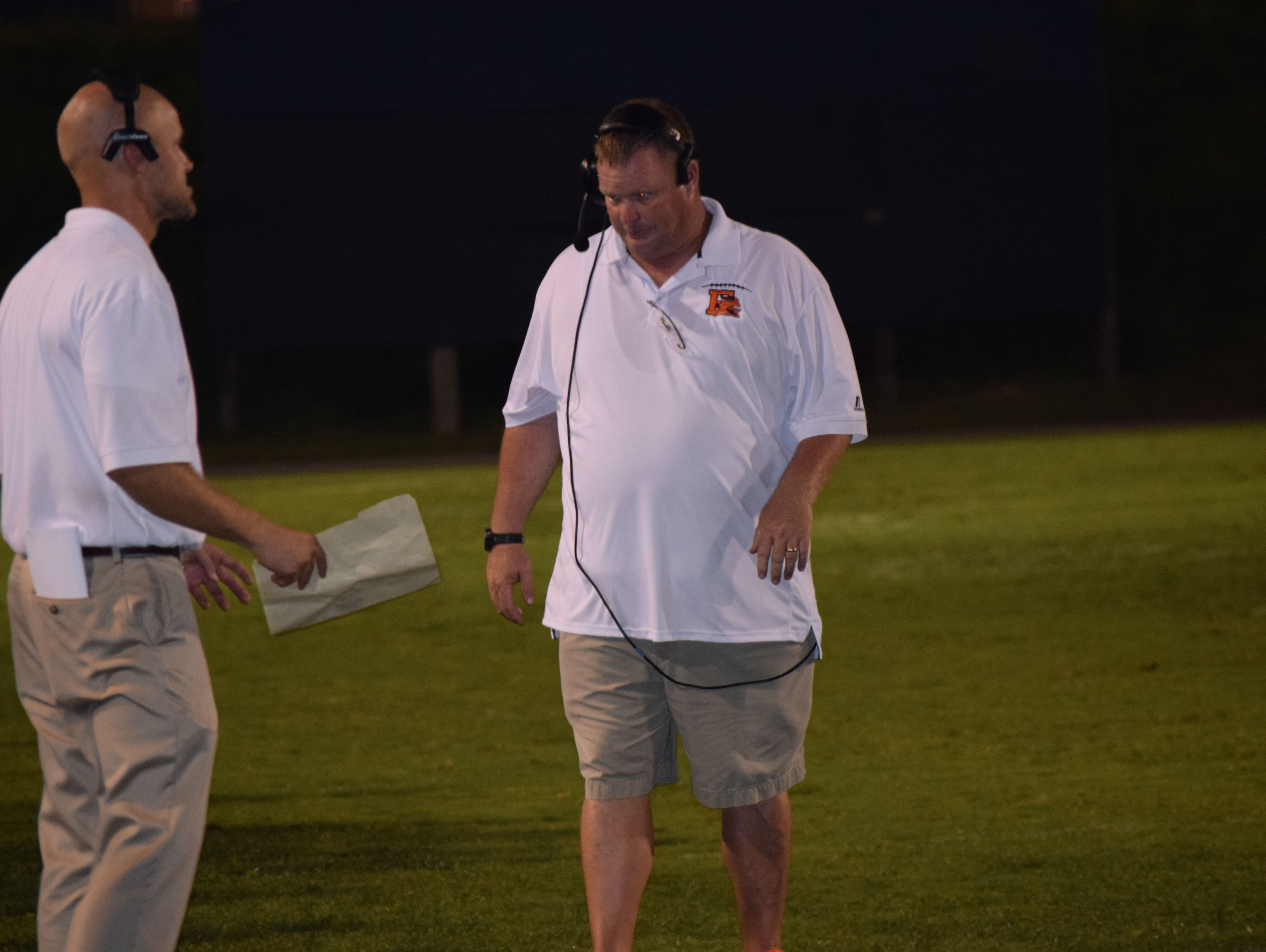 Escambia High coach Mike Davis and his team endured a long second half in a 40-20 loss against Lake City-Columbia