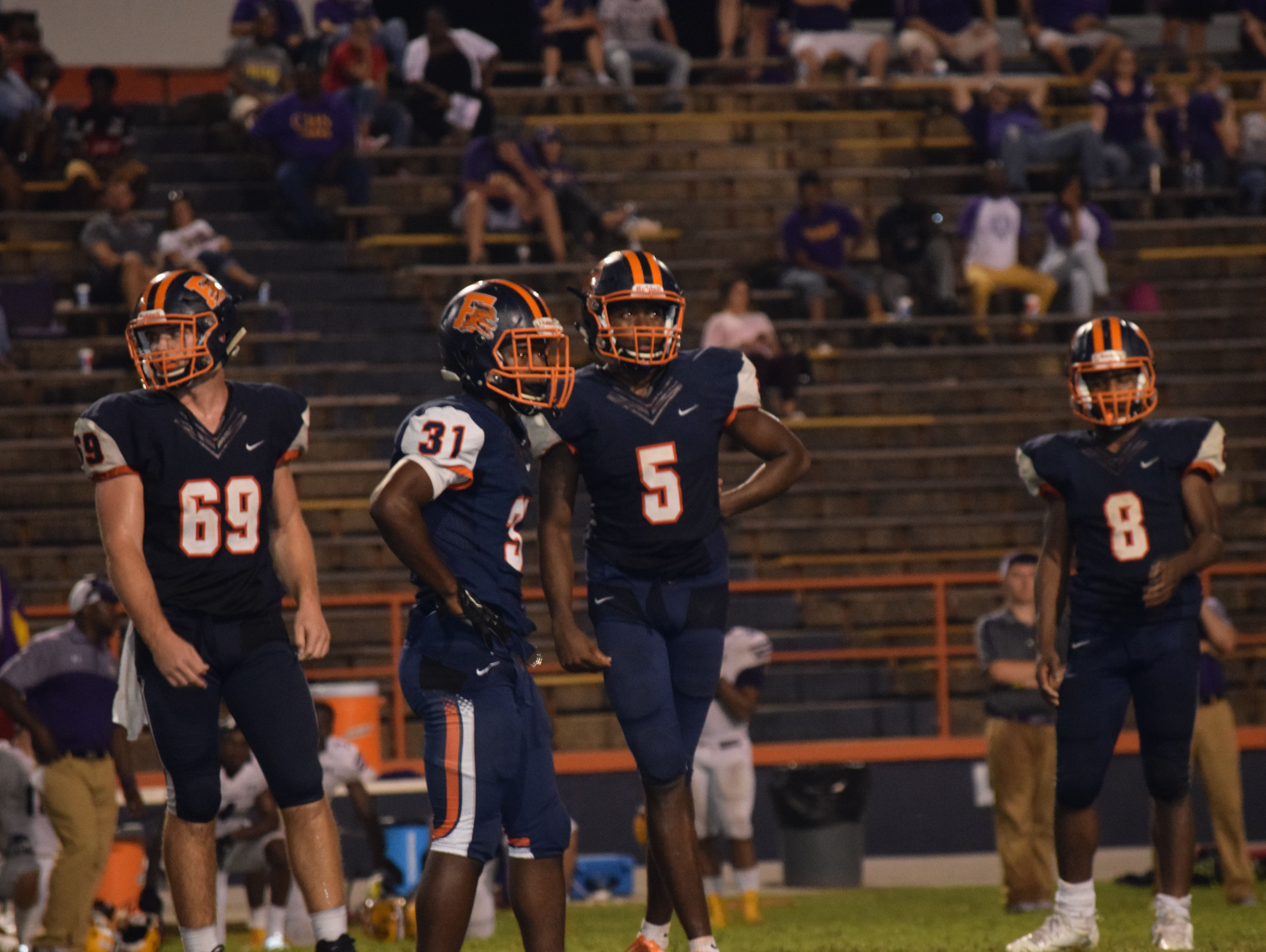 It became a tough night for Escambia High quarterback Z'khari Blocker (5) and teammates in a loss against Lake City-Columbia.