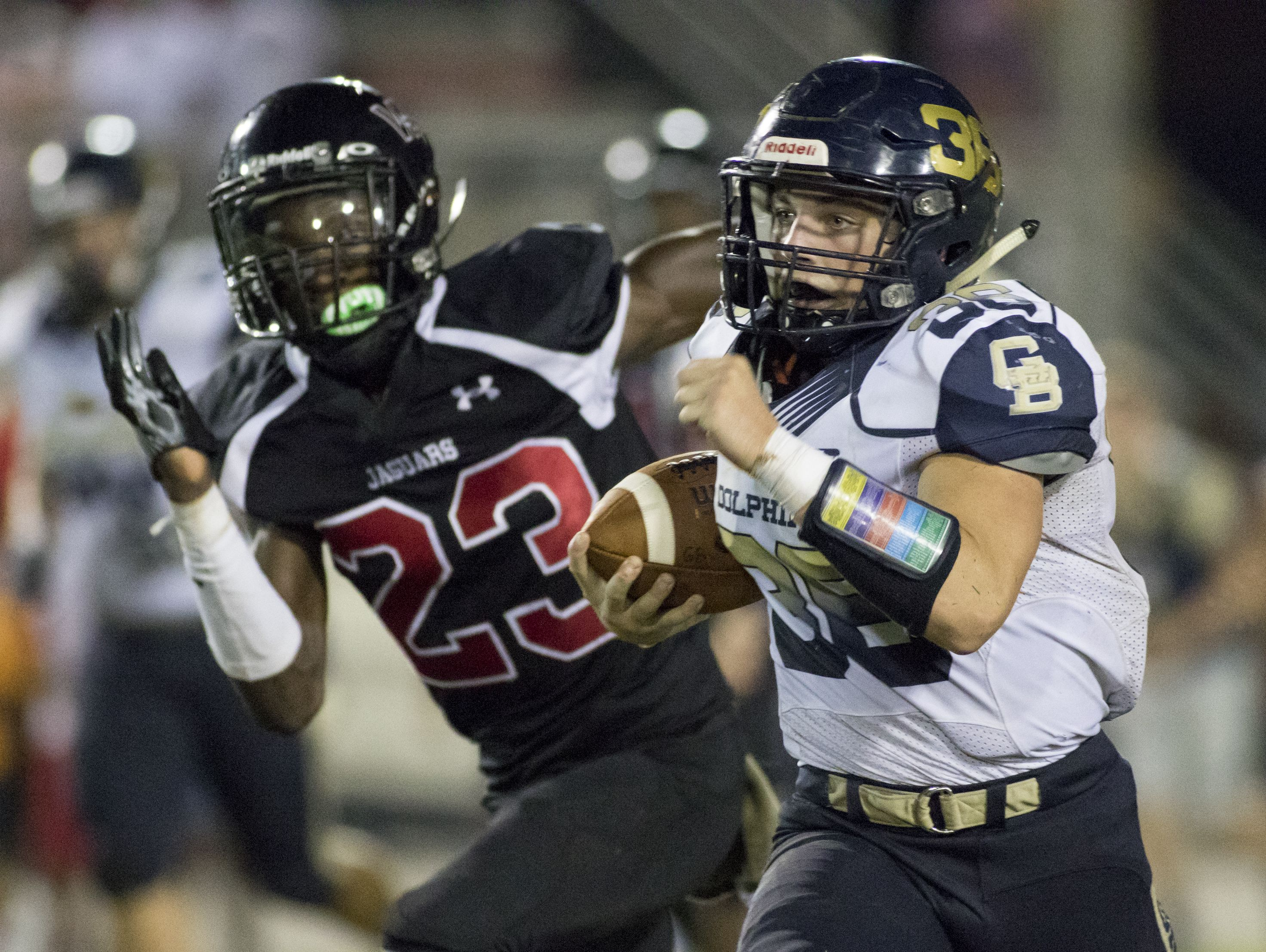 Da'Quaris Gaines (23) pursues Tyler Dittmer (36) during the Gulf Breeze v West Florida football game in Pensacola, FL on Friday, September 23, 2016.