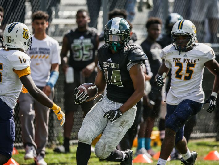 Detroit Cass Tech's Jaron Mangham runs the ball against Detroit East English on Saturday, Sept. 24, 2016, in Detroit.