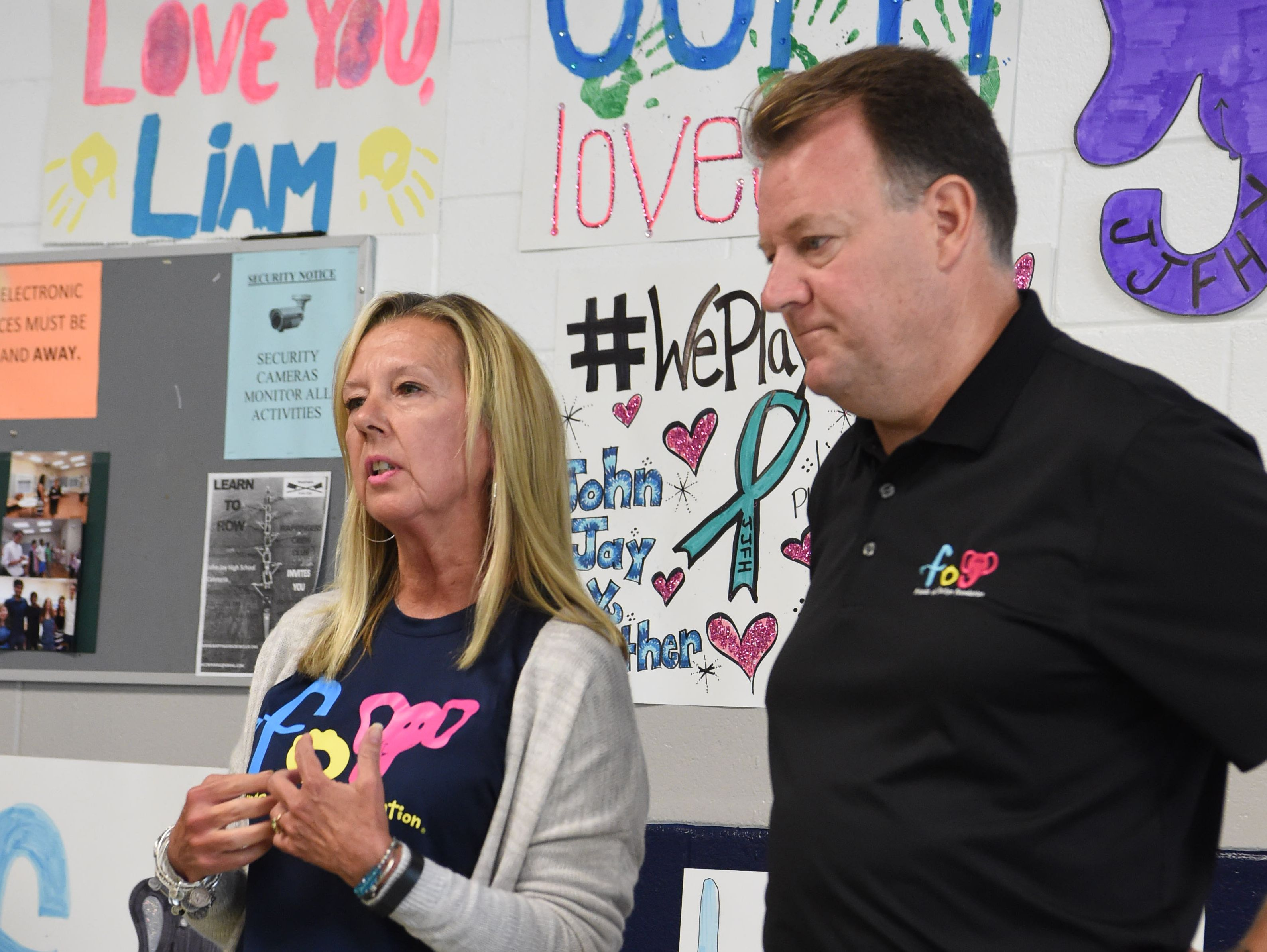 """Lynda Murphy, left, and Denis Murphy, right, the parents of Jaclyn Murphy, the inspiration behind the Friends of Jaclyn Foundation, speak at John Jay High School before the """"adoption"""" of Liam, 5, by the school's field hockey team."""