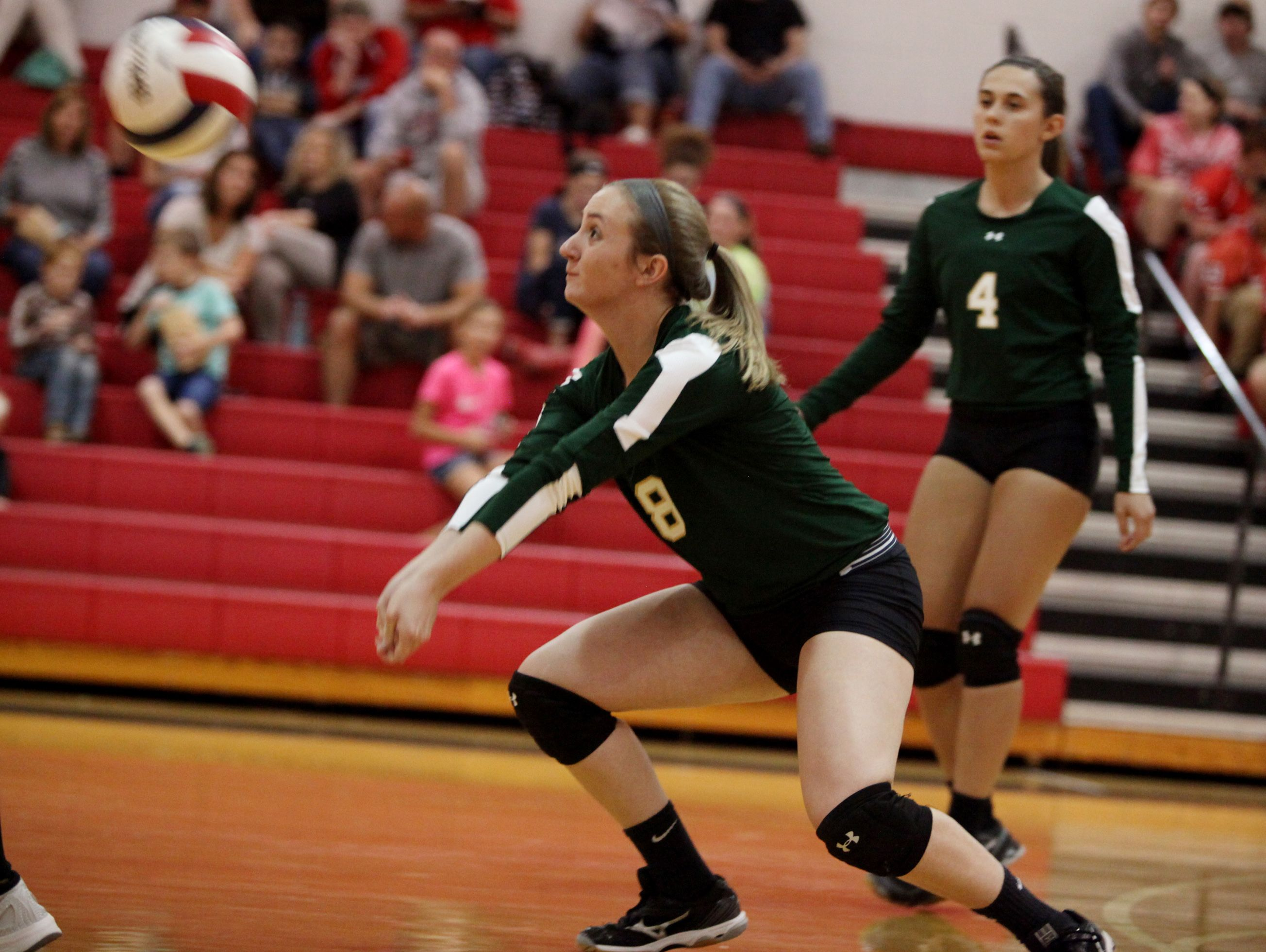 Wilson Memorial's Grace Carter bumps the ball during the volleyball game at Riverheads High School on Tuesday, Sept. 27, 2016.