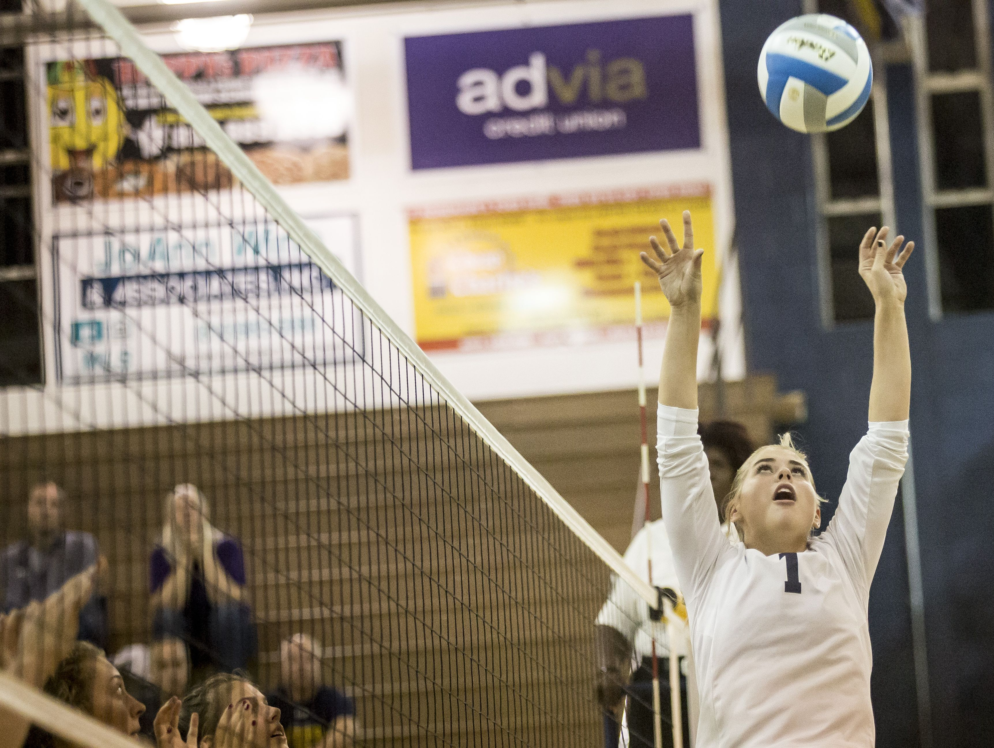 Port Huron Northern senior Brooke Bowerman sets the ball during a volleyball game Tuesday, September 27, 2016 at Port Huron Northern High School.