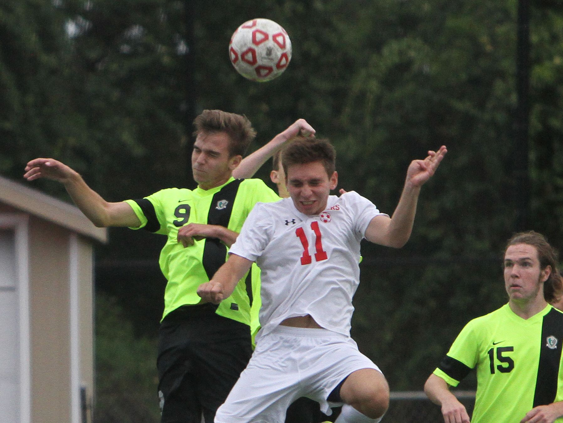 Lakeland's Matias Prando, left, and Somers' John Riina both go up for a header during their game at Somers High School on Wednesday. Lakeland won the game 2-1 in overtime.