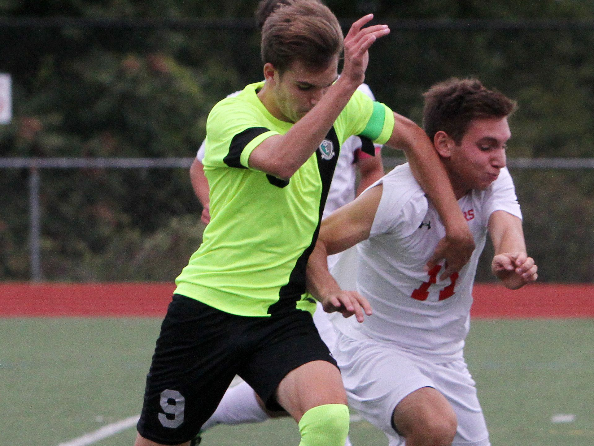 From left, Lakeland's Matias Prando (9) and Somers' John Riina (11) battle for ball control during soccer action at Somers High School Sept. 28, 2016. Lakeland won the game 2-1 in overtime.