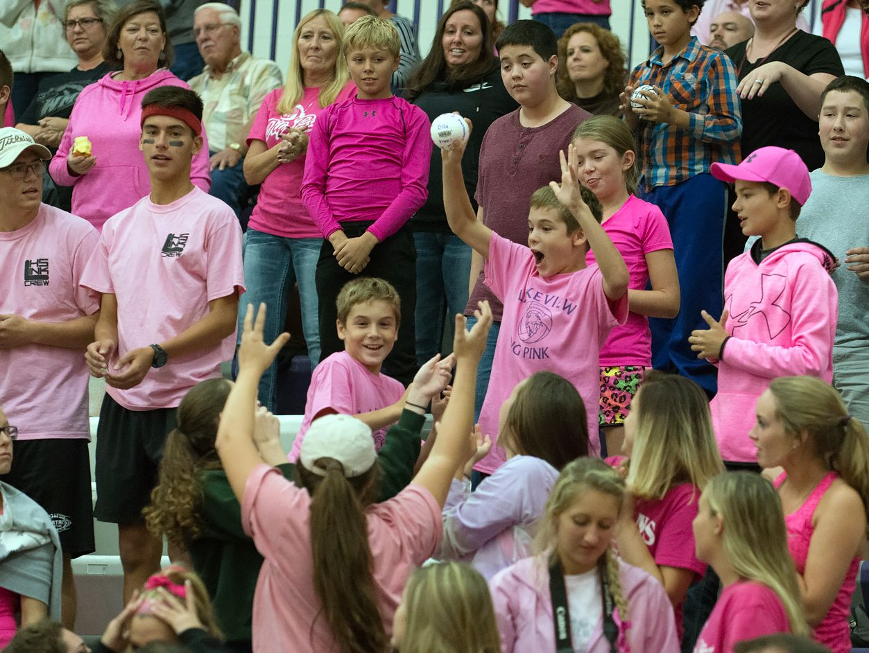 The Lakeview Student Section wait for mini volleyballs to be thrown into the crowd by varisty players Wednesday night.