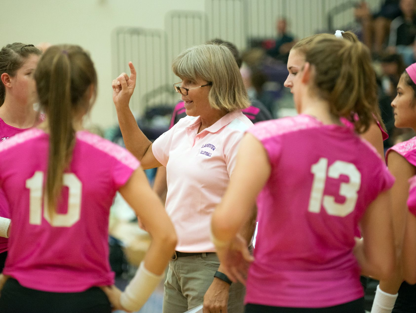 Lakeview head coach Heather Sawyer talks to her team during a time out Wednesday night.