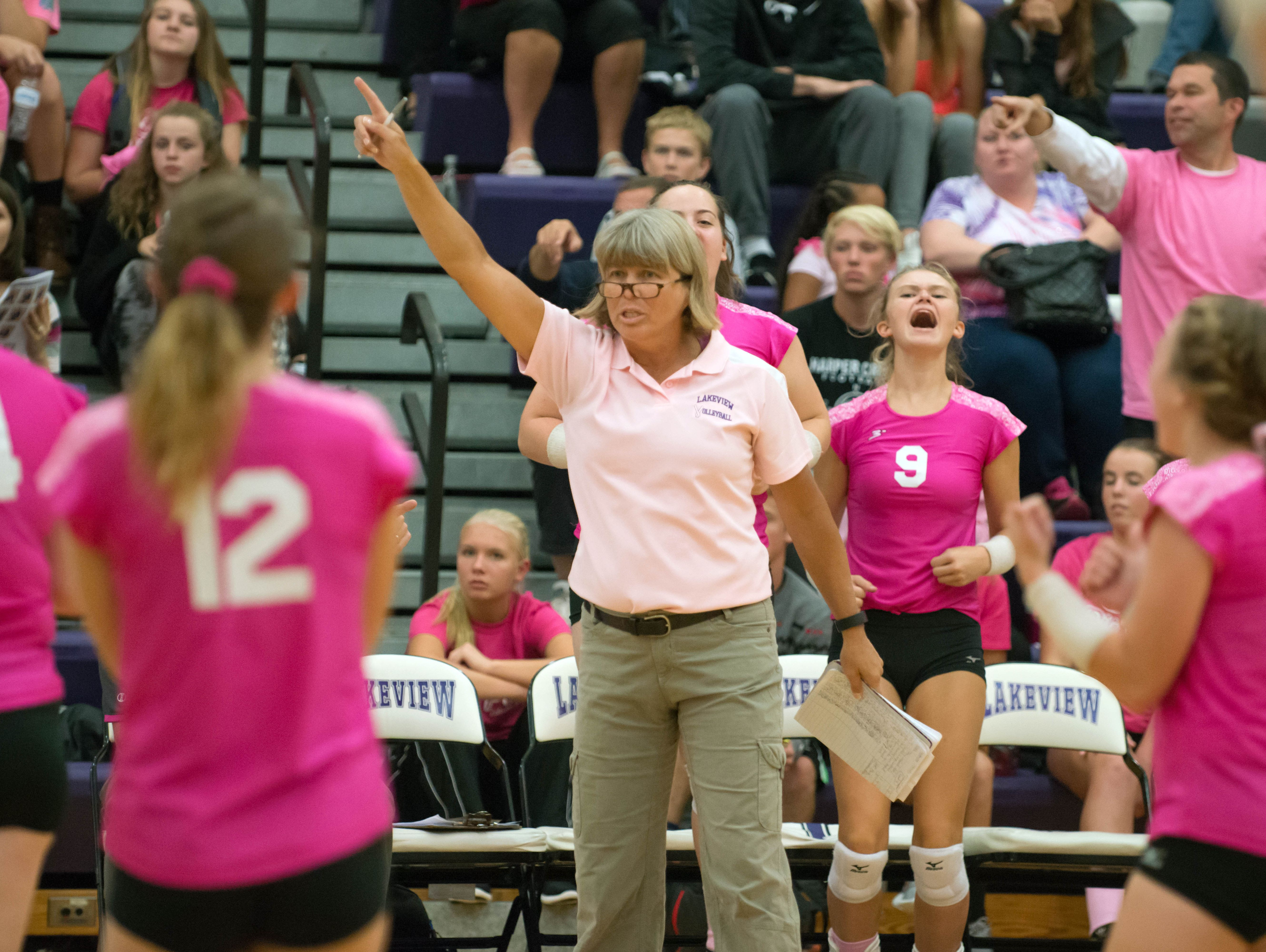 Lakeview head coach Heather Sawyer signals to her players as they win the first match against Mattawan Wednesday night.