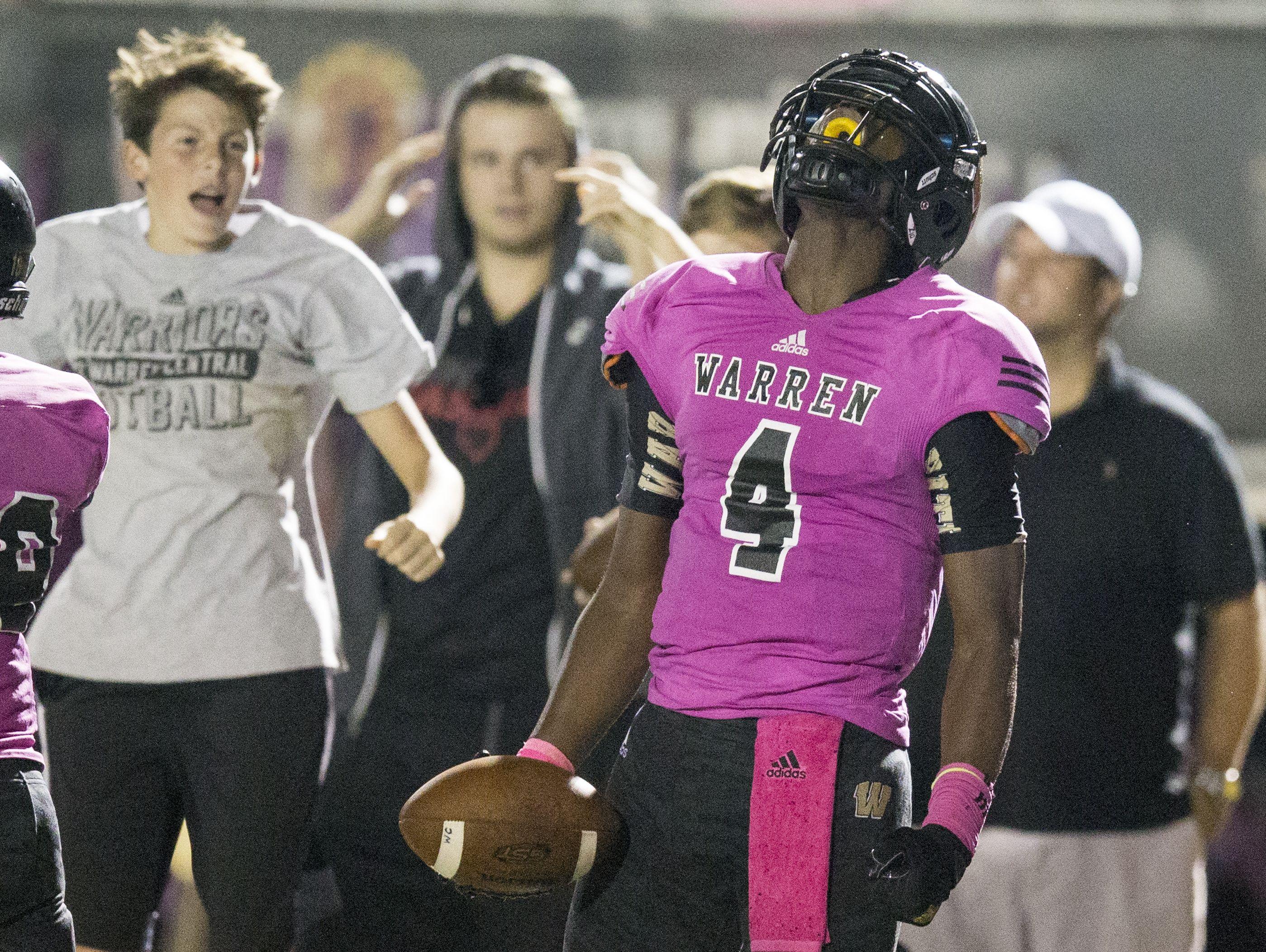 David Bell celebrates the game winning score he just made for Warren Central High School, Ben Davis at Warren Central High School football, Indianapolis, Friday, Sept. 16, 2016. WCHS won 35-34.