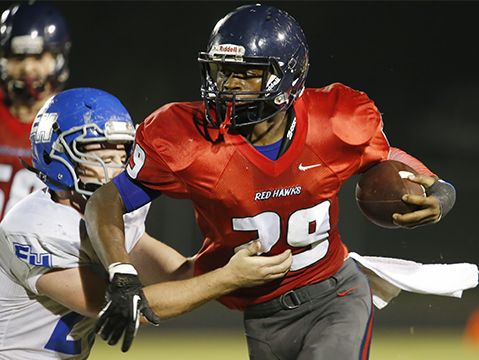 Creek Wood's Quinton Poole breaks a tackle while looking up field
