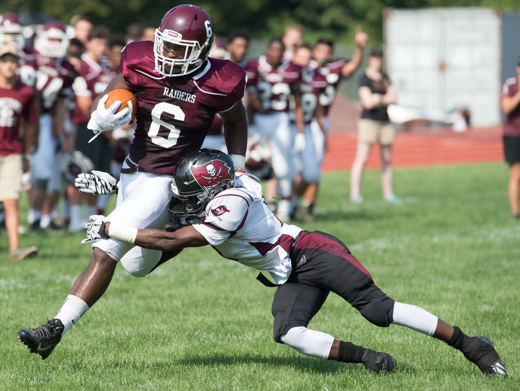 Concord's Grahm Roberts (6), shown here against Caravel's Mandela Montgomery, has rushed for more than 500 yards in the Raiders' first three games.
