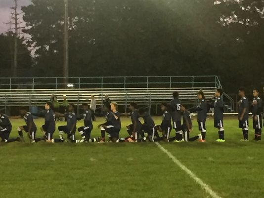 Unlike at Tuesday's game when all 18 players knelt during the anthem, seven World of Inquiry players chose to stand before Thursday's 2-1 win at Bishop Kearney. (Photo: Jeff DiVeronica, Rochester Democrat & Chronicle)