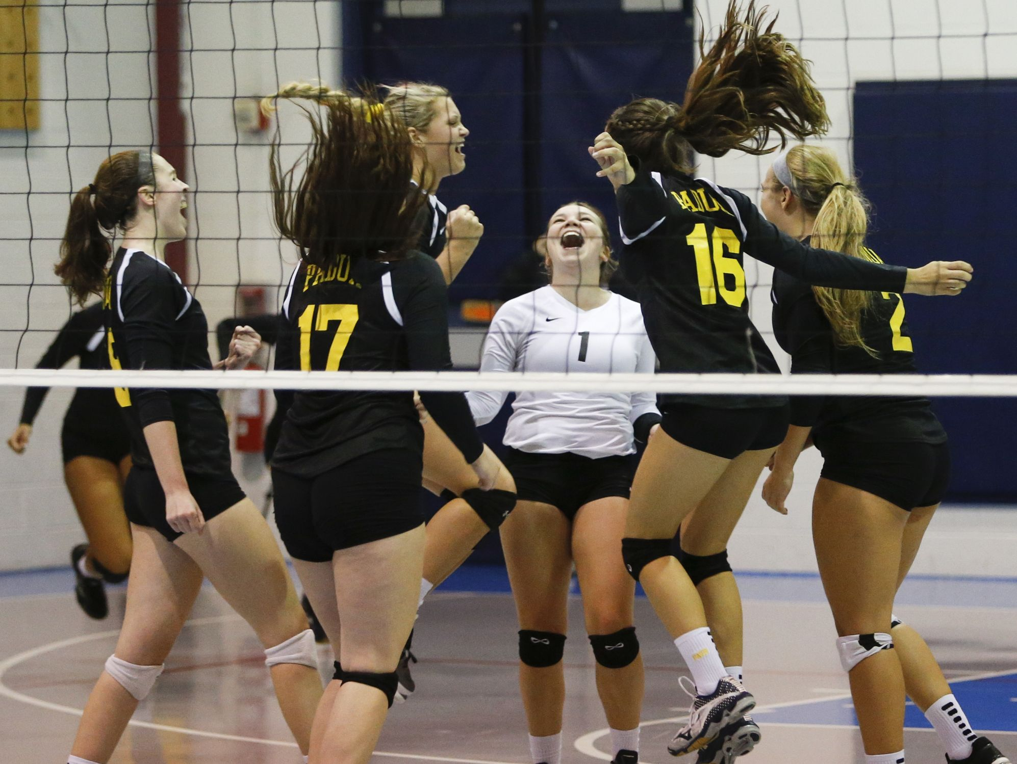 Padua celebrates after winning the third game and sweeping DMA, 3-0, at Delaware Military Academy Thursday.