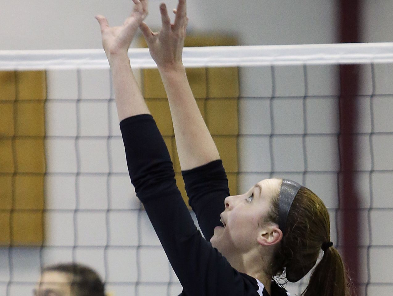 Padua's Emma Lucey sets in the second game of Padua's 3-0 win at Delaware Military Academy Thursday.