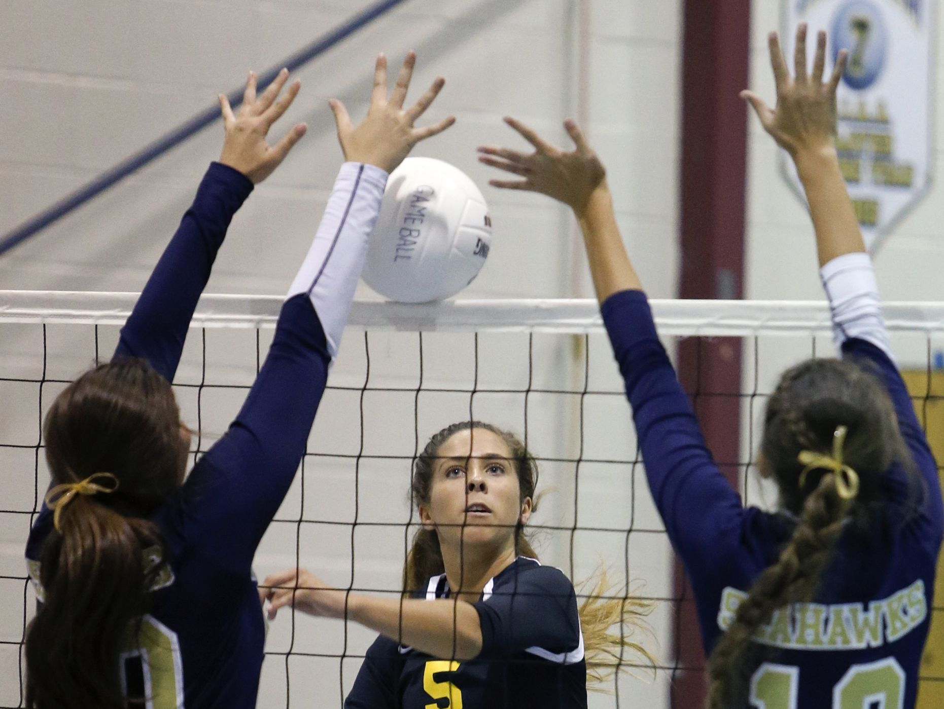 Padua's Claire Bisson watches after hitting against DMA's Jackie Shields (left) and Nina Tindall in the third game of Padua's 3-0 win at Delaware Military Academy Thursday.