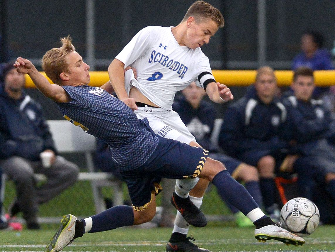 Webster Thomas' Ryan Leask, left, tips the ball away from Webster Schroeder's Kyle McMillen during Webster Schroeder's 2-1 win.