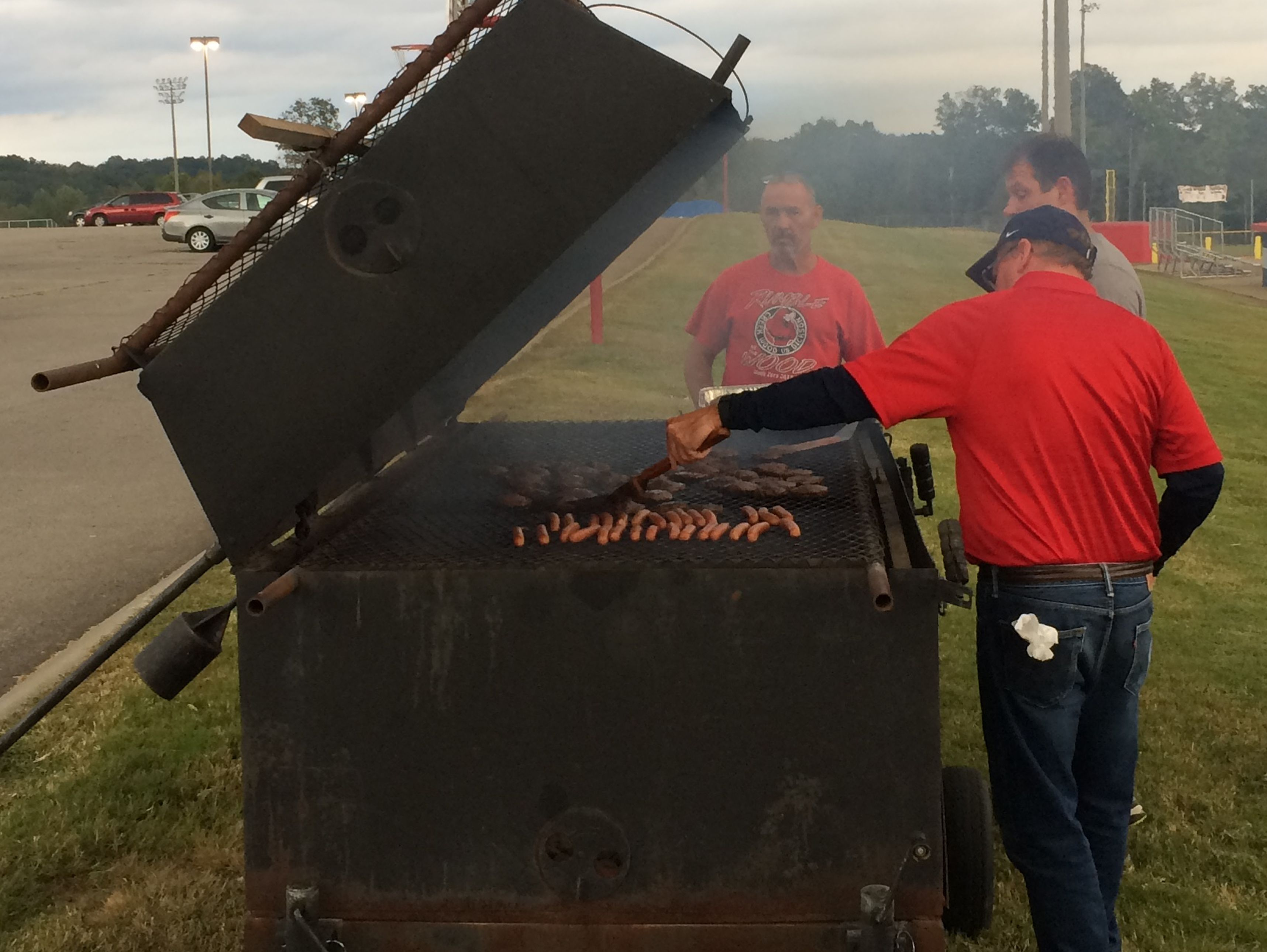 Hamburgers are grilled before the fans arrive at the Creek Wood vs. Hillwood game on Friday, Sept. 30 2016.