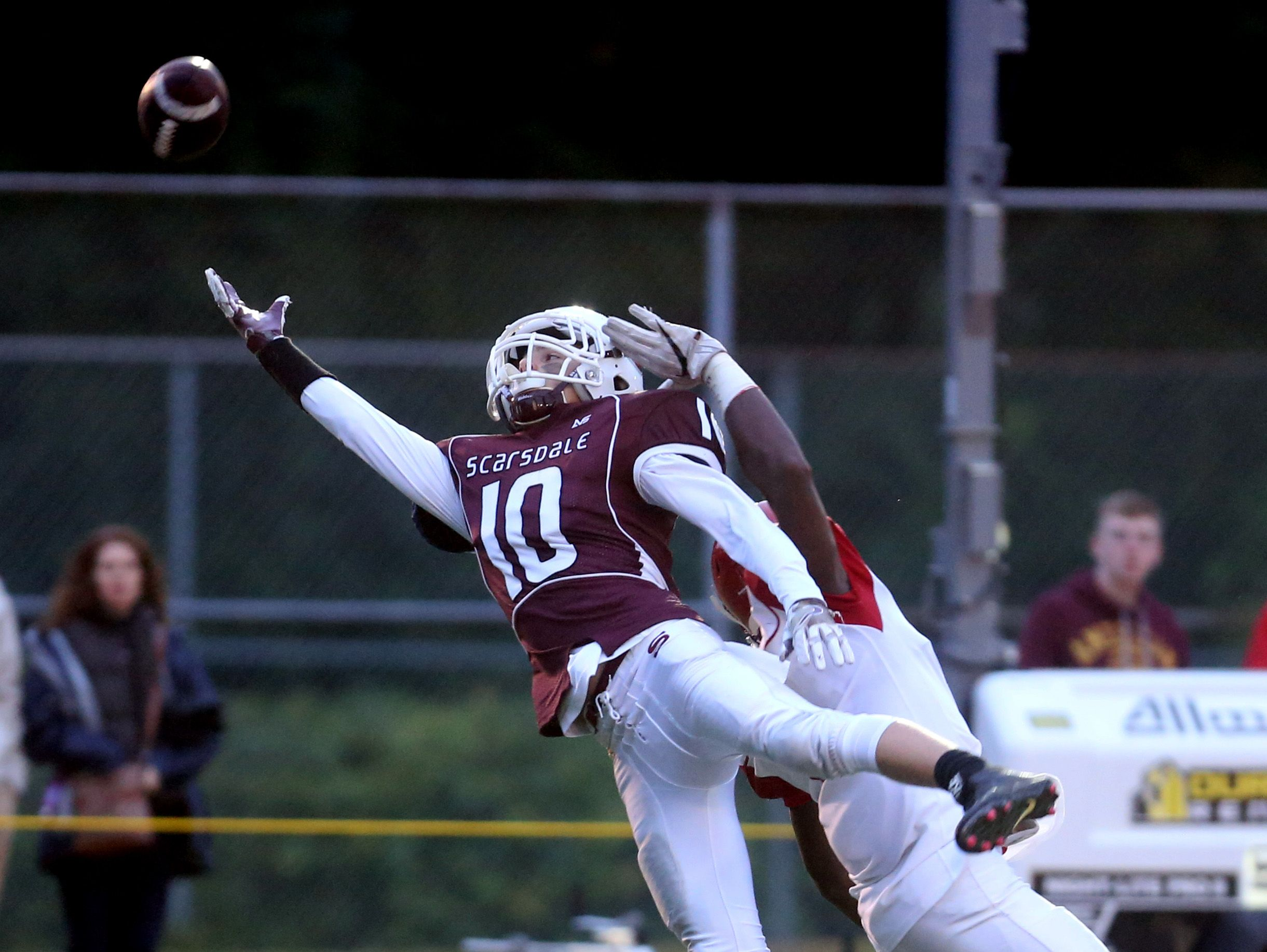 Scarsdale free safety Thomas Jacobson breaks up a pass intended for North Rockland's Jayden Cook during their game at Scarsdale High School on Friday. Scarsdale defeated North Rockland 31-7.