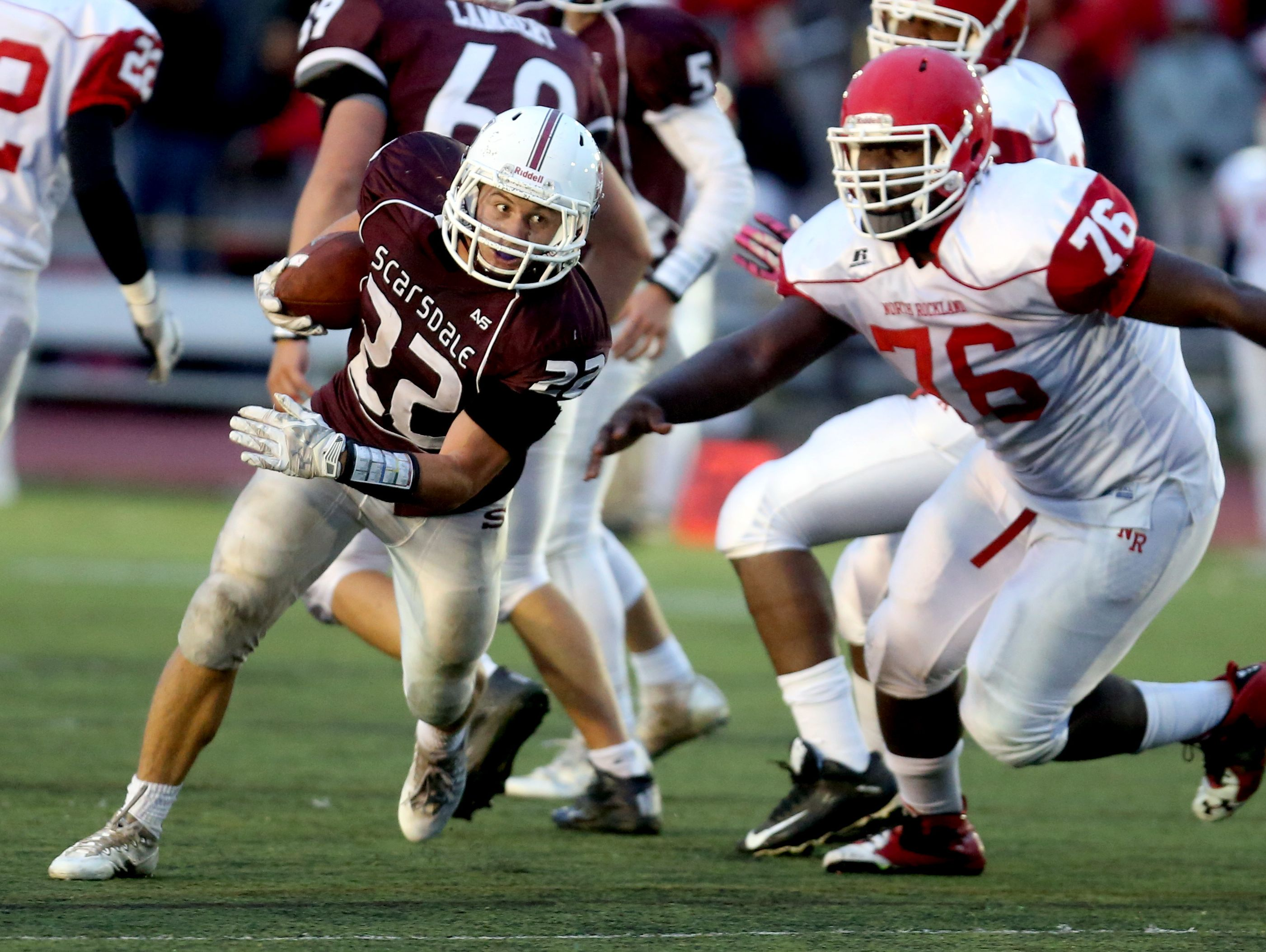 Scarsdale running back Nick Leone evades North Rockland's Hervens Mulatre during a varsity football game at Scarsdale High School Sept. 30, 3016. Scarsdale defeated North Rockland 31-7.