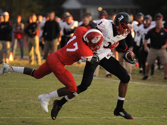 New Albany's Davin Alexander fights off a Jeffersonville defender in the Bulldogs' 42-14 win over the Red Devils Friday night.