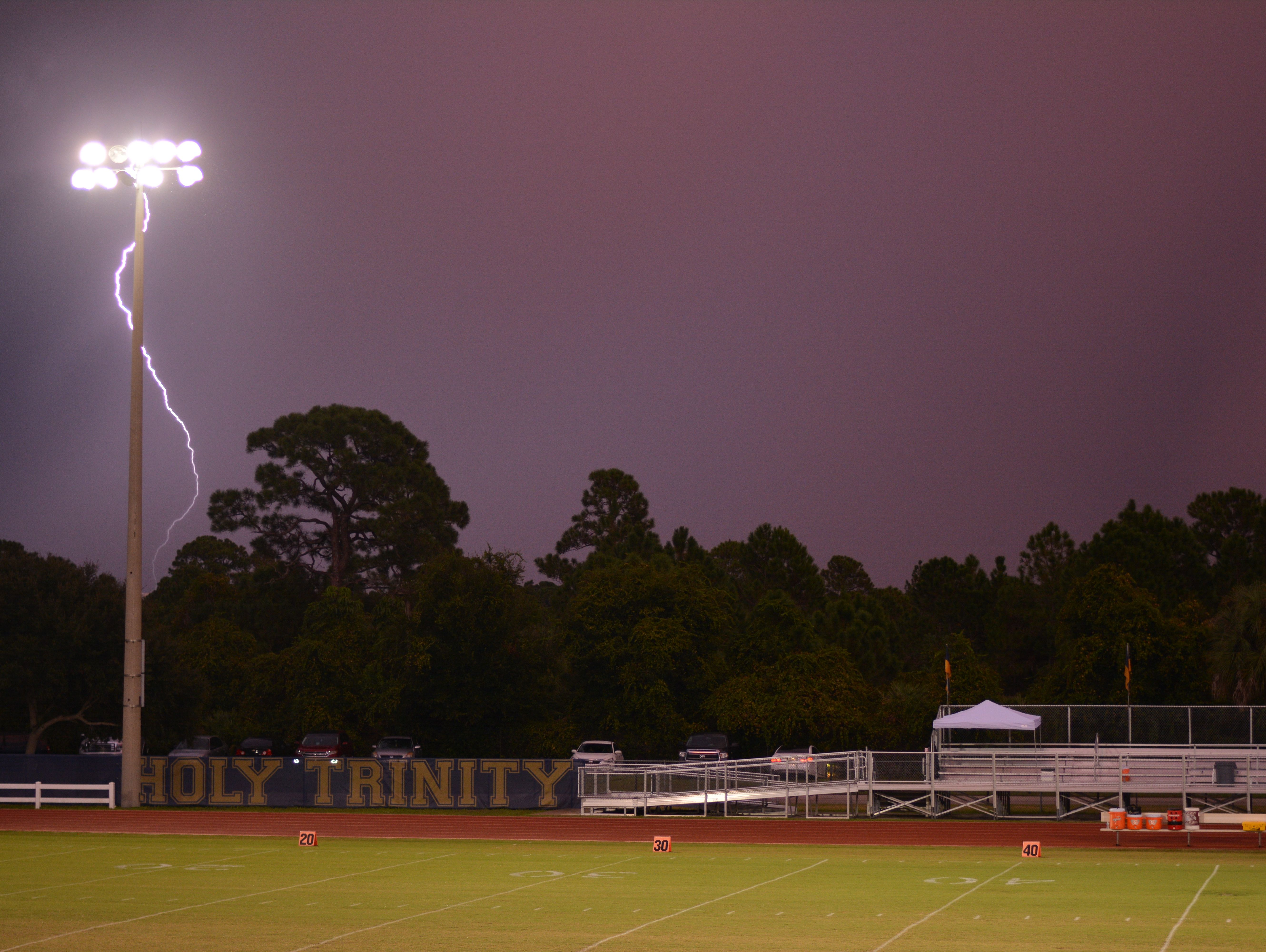 Lightning delayed the start of the Trinity Christian ay Holy Trinity game in Melbourne.