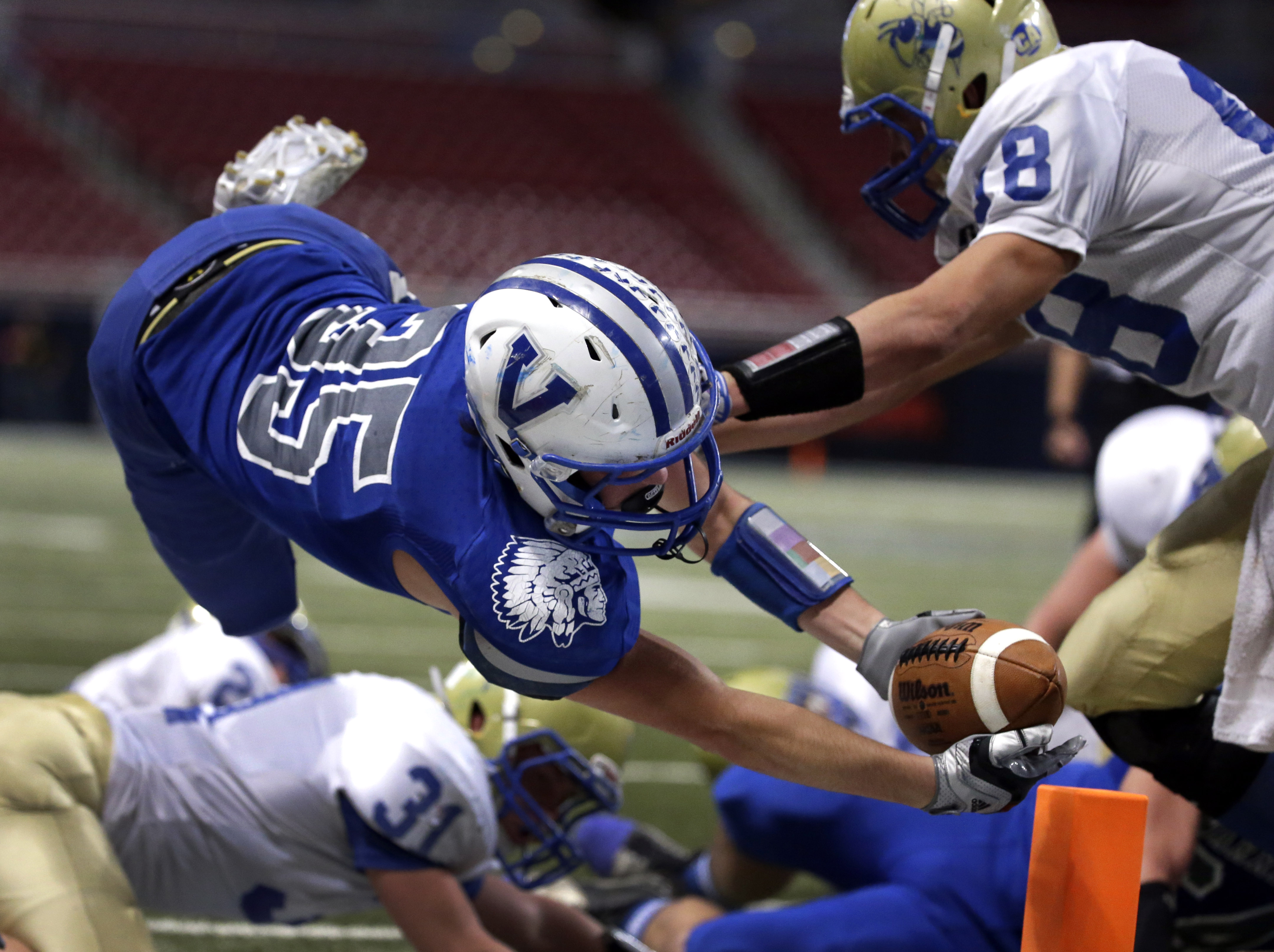 Valle Catholic's Nicholas Oberle, left, dives but comes up just short of the end zone as his is pushed out of bounds by Penney's Telly Harper, right, during the first half in the Missouri Class 1 state high school football championship Saturday, Nov. 28, 2015, in St. Louis. (AP Photo/Jeff Roberson) ORG XMIT: MOJR107
