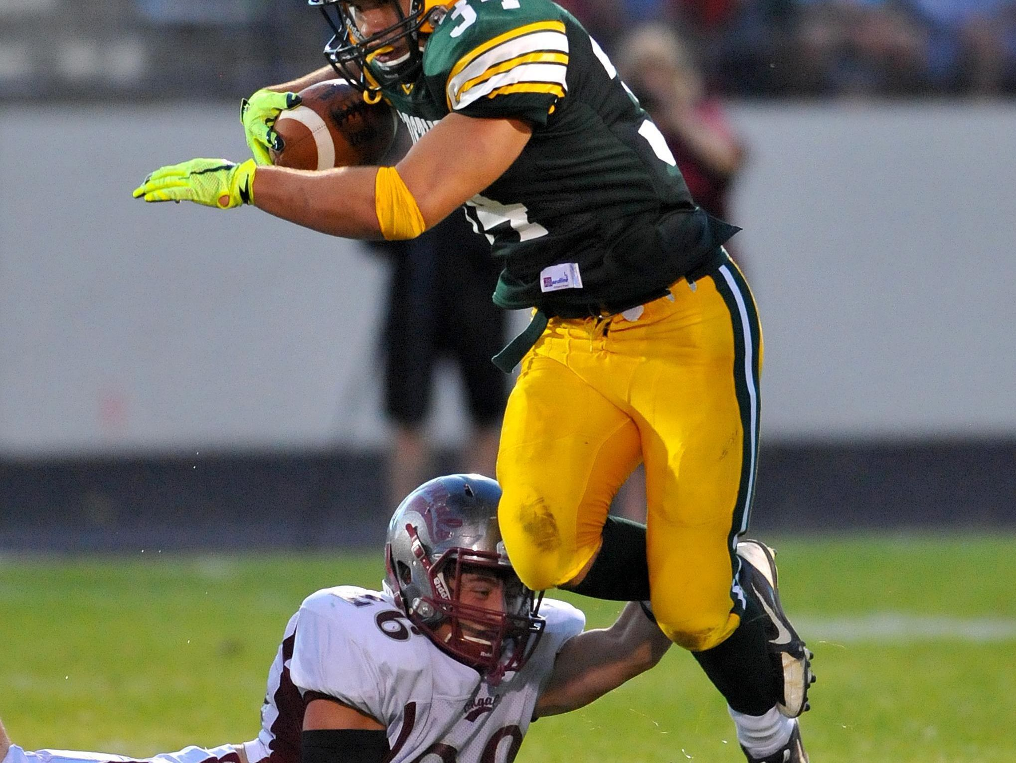 TRIBUNE PHOTO/RION SANDERSC.M. Russell High tailback Andrew Grinde suffered a shoulder injury during the first half of Friday's game against Billings Senior. CMR's Andrew Grinde avoids Helena High defender Taustin Hauk as he looks for running room during Friday night's game at Memorial Stadium.