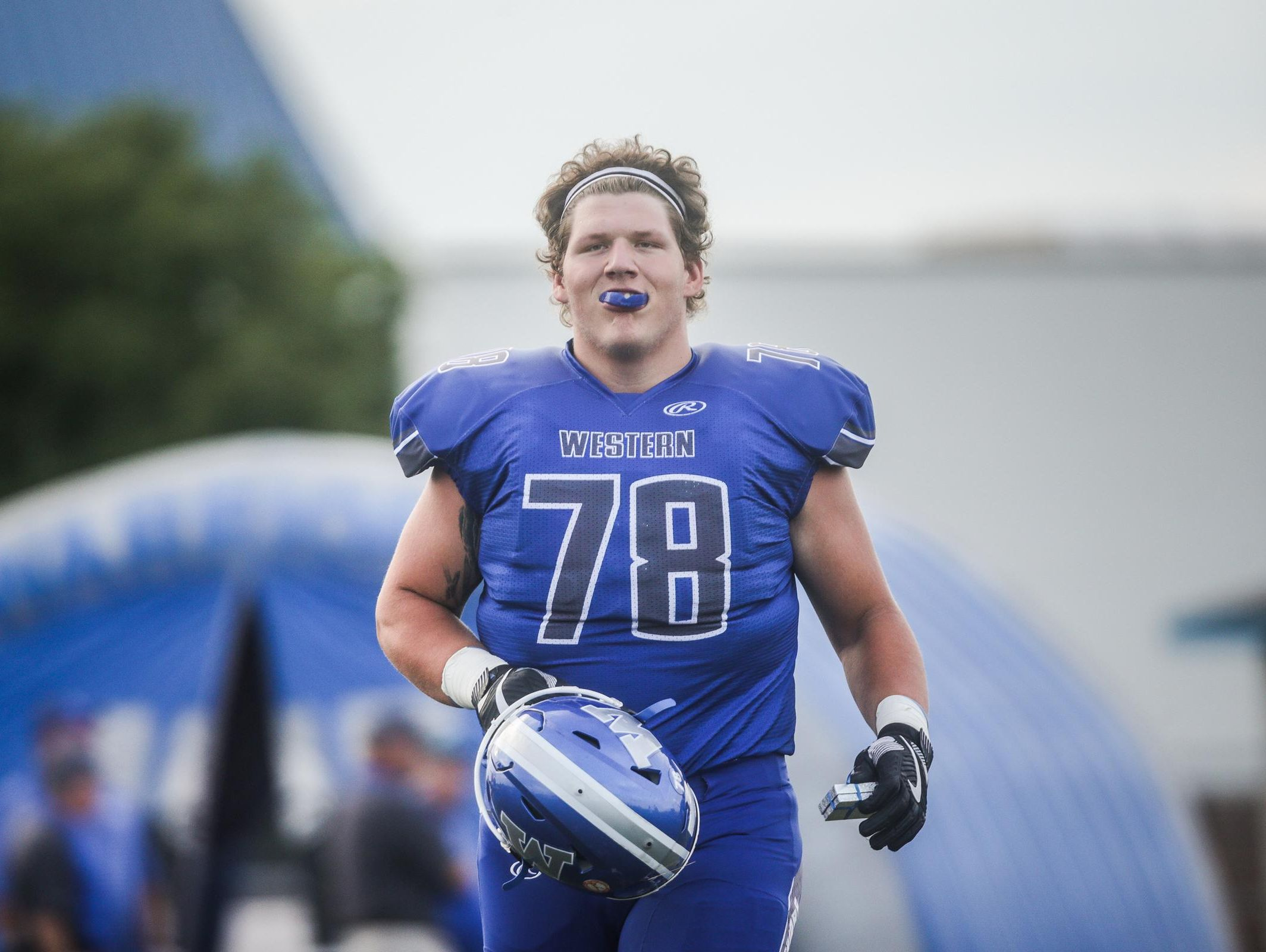 Walled Lake Western's Robert Hudson before his team game against Northville on Monday, September 9, 2016, at Warriors Stadium in Walled Lake, MI.
