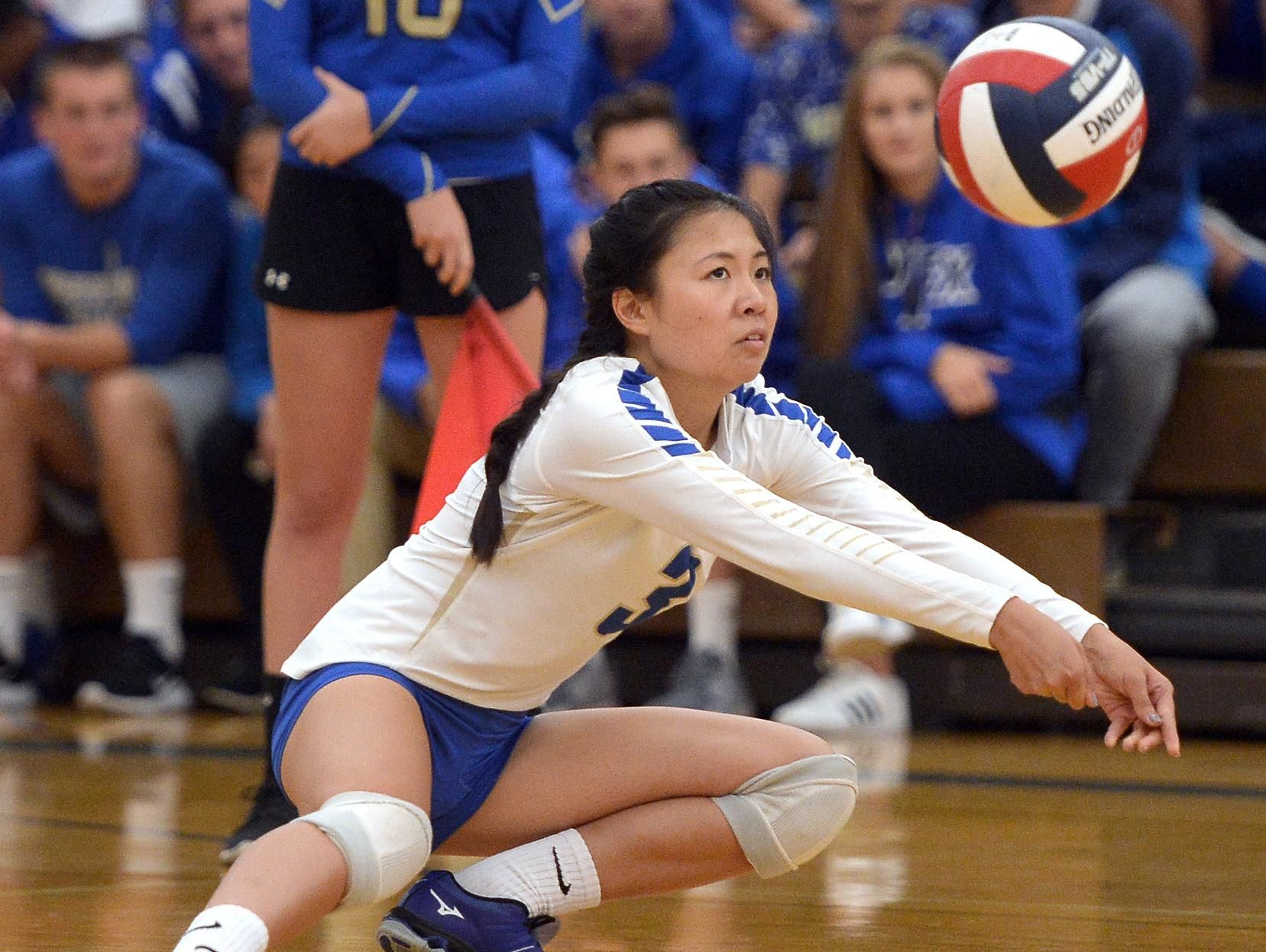 Webster Schroeder's Selena Zhang passes the ball towards the net.