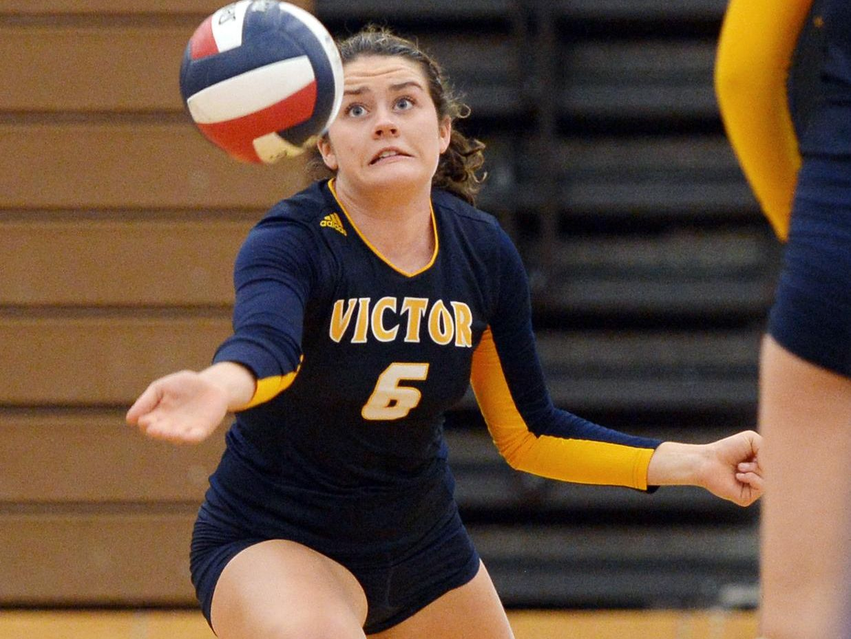 Victor's Carrie Stewart reaches for the ball.