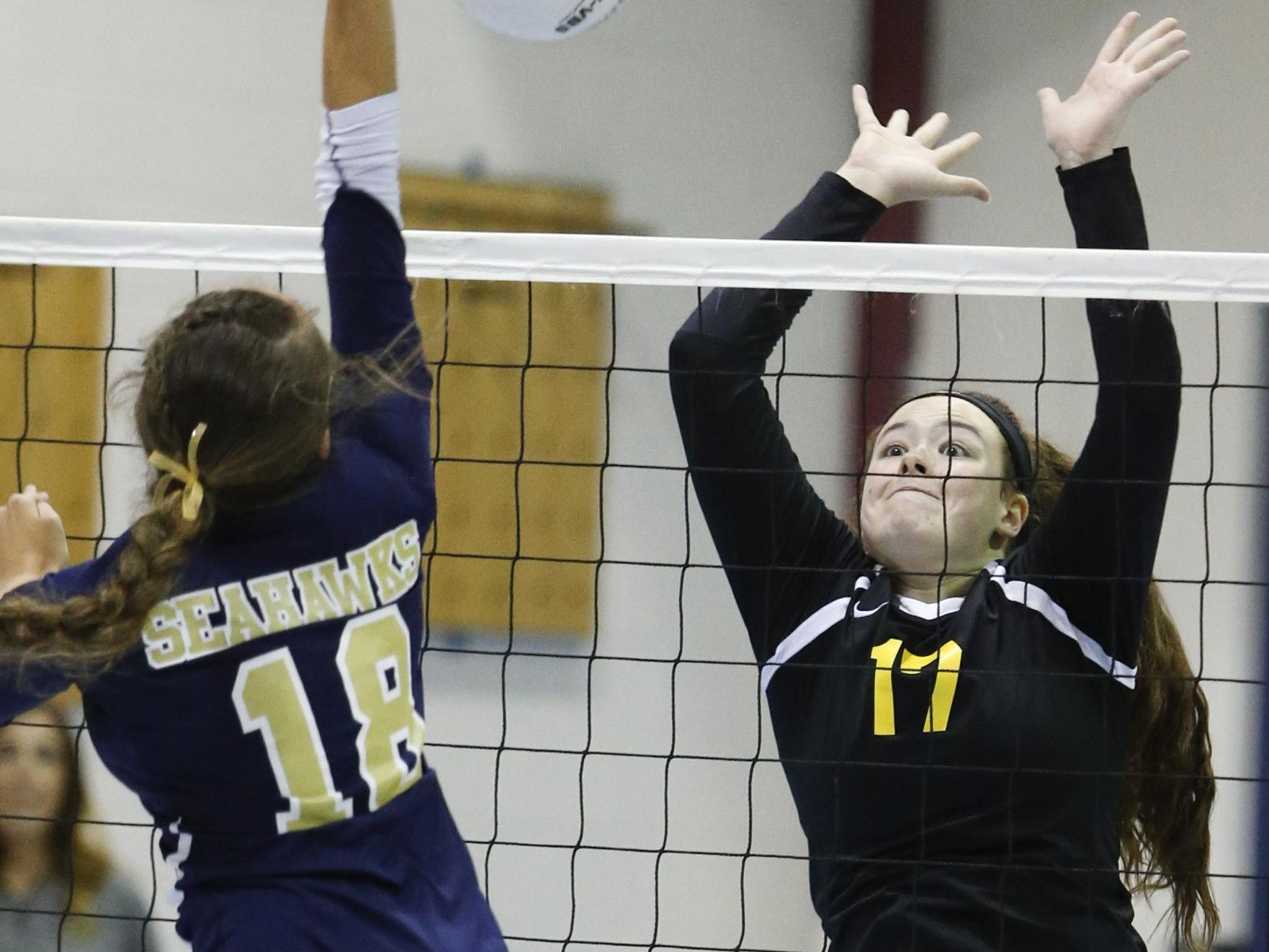 Delaware Military's Nina Tindall tries to hit past Padua's Gabriella Welsh in the third game of Padua's 3-0 win at Delaware Military Academy Thursday.